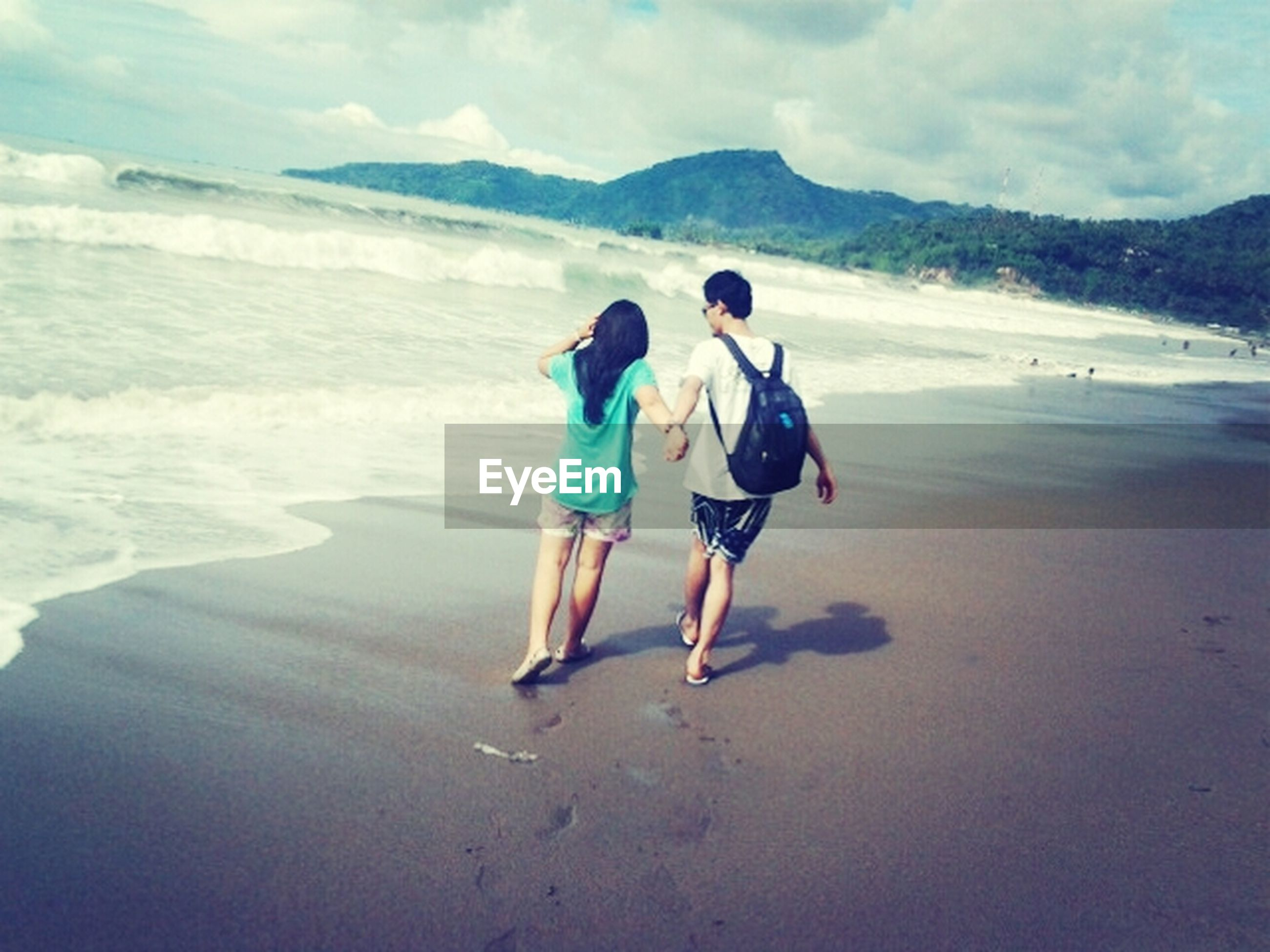 water, beach, leisure activity, lifestyles, sea, full length, vacations, sand, togetherness, sky, shore, boys, childhood, beauty in nature, nature, scenics, enjoyment, bonding