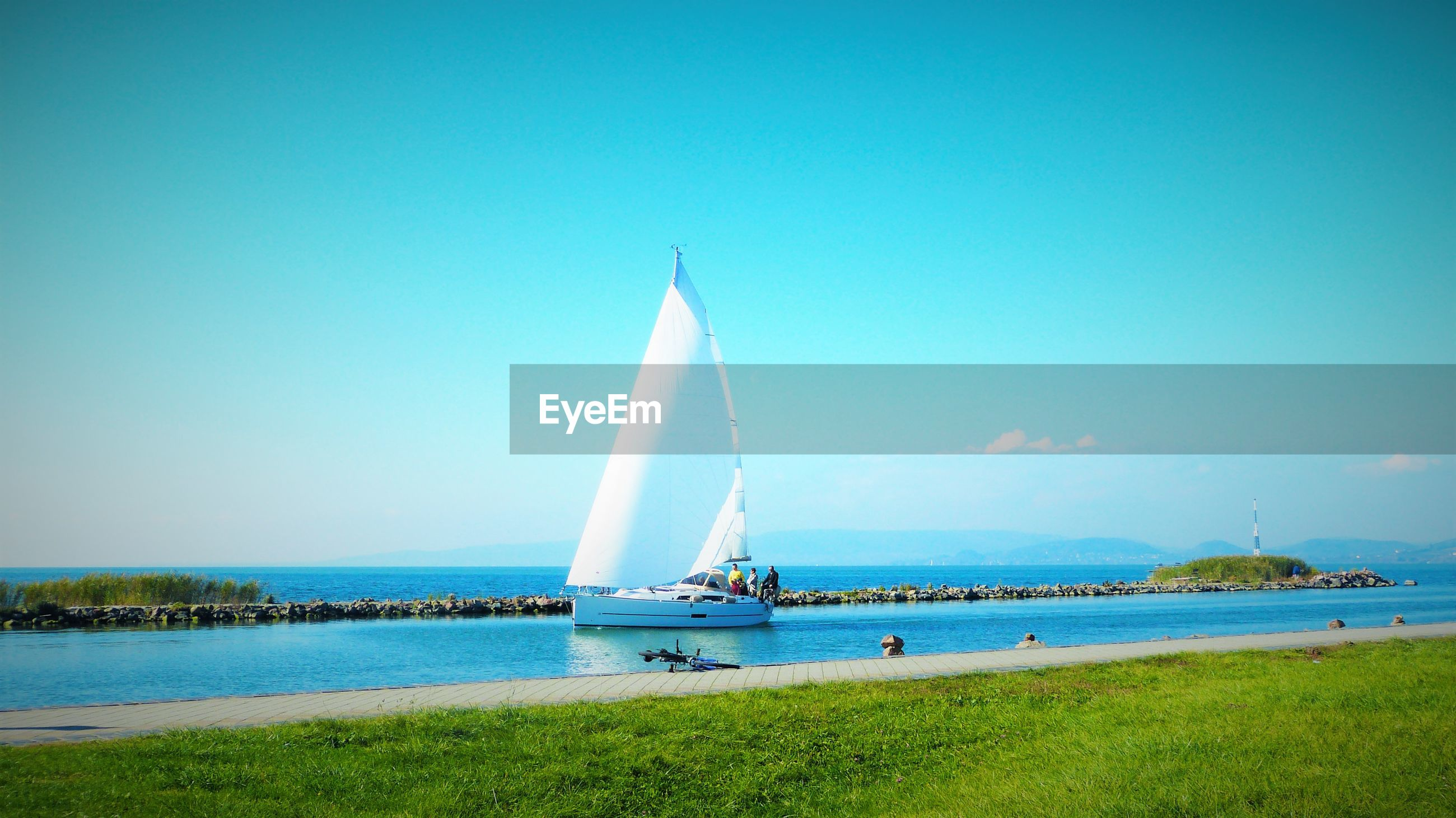 sky, clear sky, blue, transportation, sea, water, nautical vessel, nature, outdoors, day, no people, horizon over water, beauty in nature, sailboat, yachting