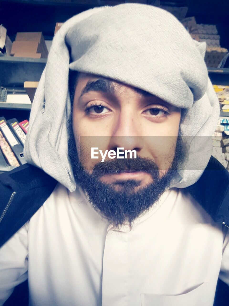 beard, real people, towel, looking at camera, hood - clothing, portrait, hooded shirt, lifestyles, human face, front view, one person, close-up, cap, day, indoors, young adult, people
