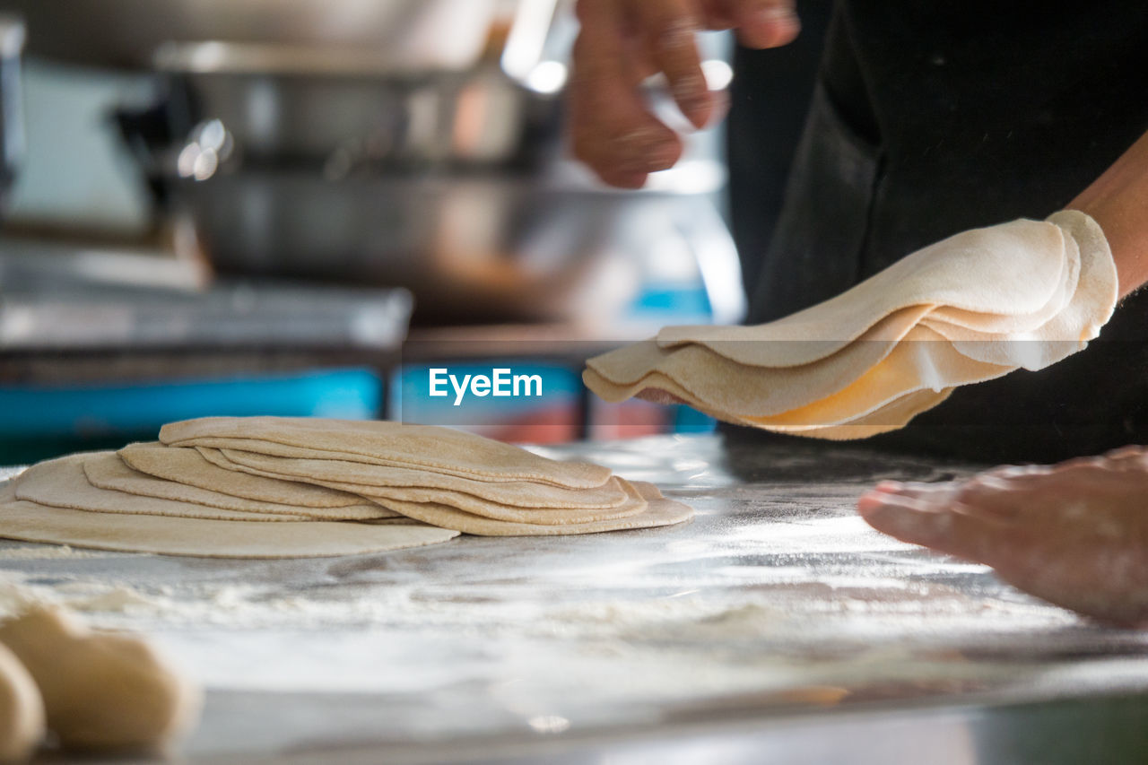 Close-Up Of Person Working On Table