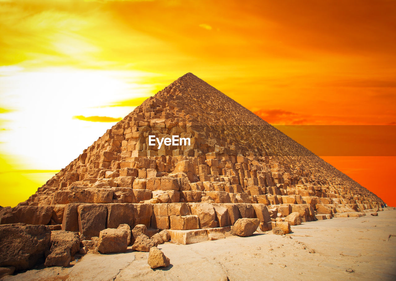pyramid against sky during sunset