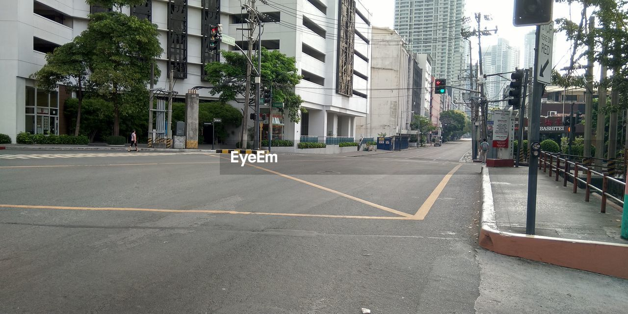 SURFACE LEVEL OF STREET AMIDST BUILDINGS