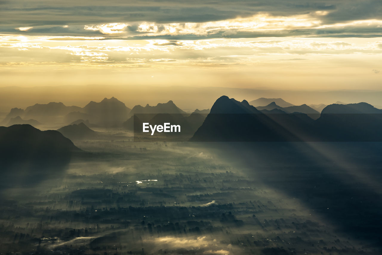 cloud - sky, sky, sunset, beauty in nature, scenics - nature, tranquil scene, tranquility, mountain, nature, no people, mountain range, idyllic, sunbeam, orange color, sunlight, non-urban scene, environment, aerial view, outdoors, landscape