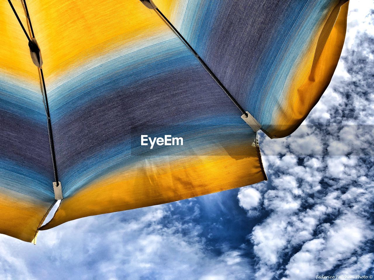 day, sky, nature, cloud - sky, no people, outdoors, yellow, low angle view, textile, close-up, pattern, transportation, sunlight, beauty in nature, blue, scenics - nature, textured, motion, mode of transportation