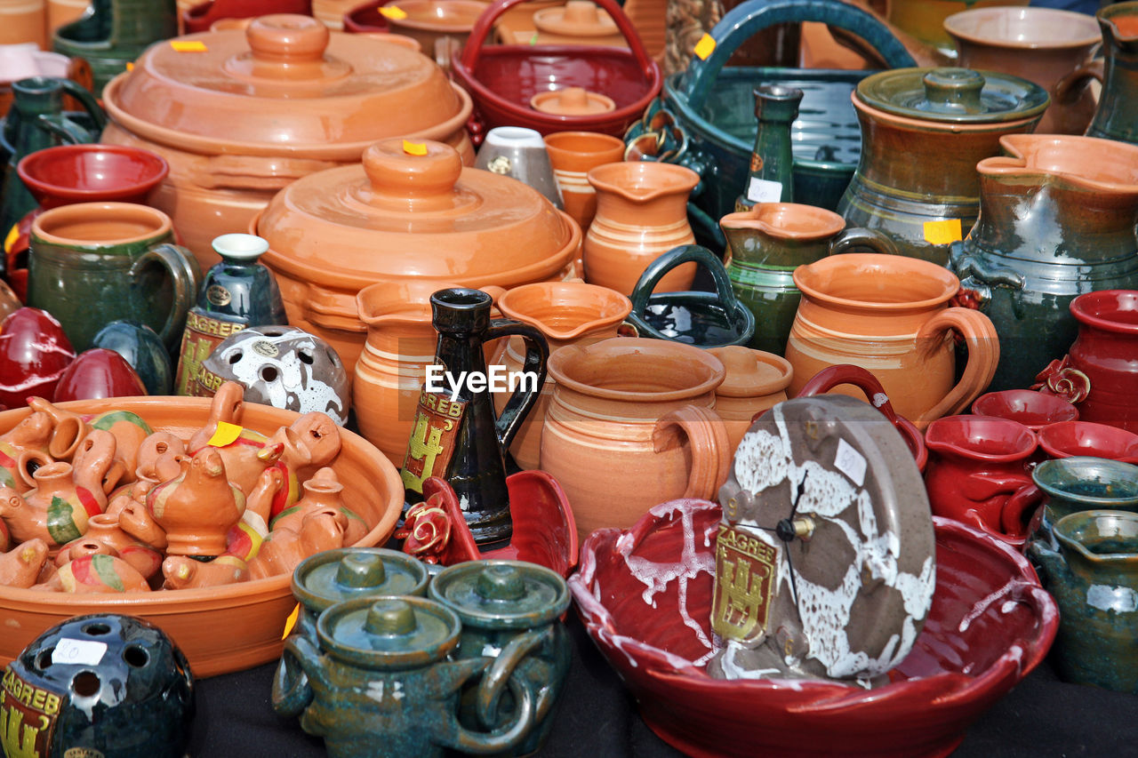 High Angle View Of Handmade Earthenware Pot Containers For Sale