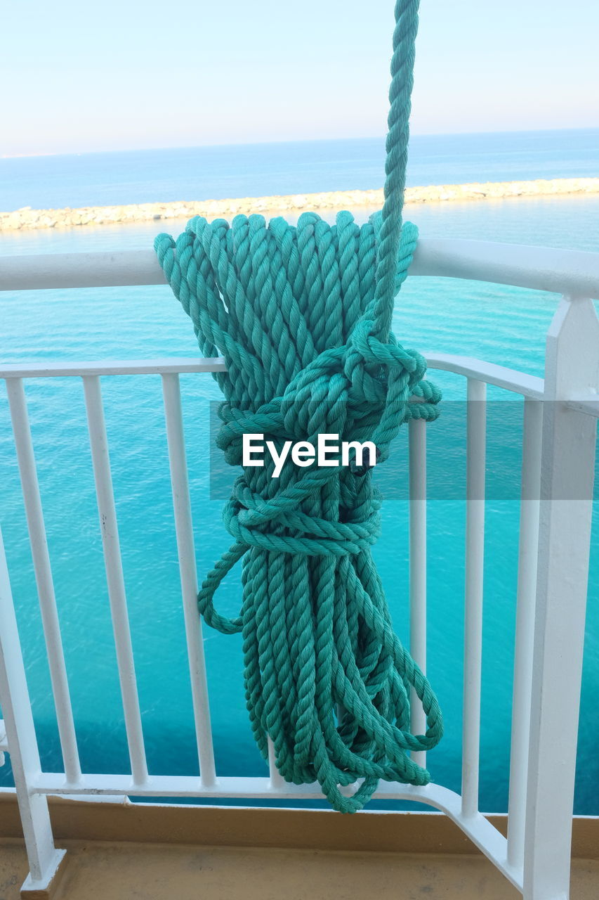 sea, rope, water, no people, railing, nautical vessel, horizon over water, outdoors, day, close-up, nature, beauty in nature, sky, scenics, boat deck
