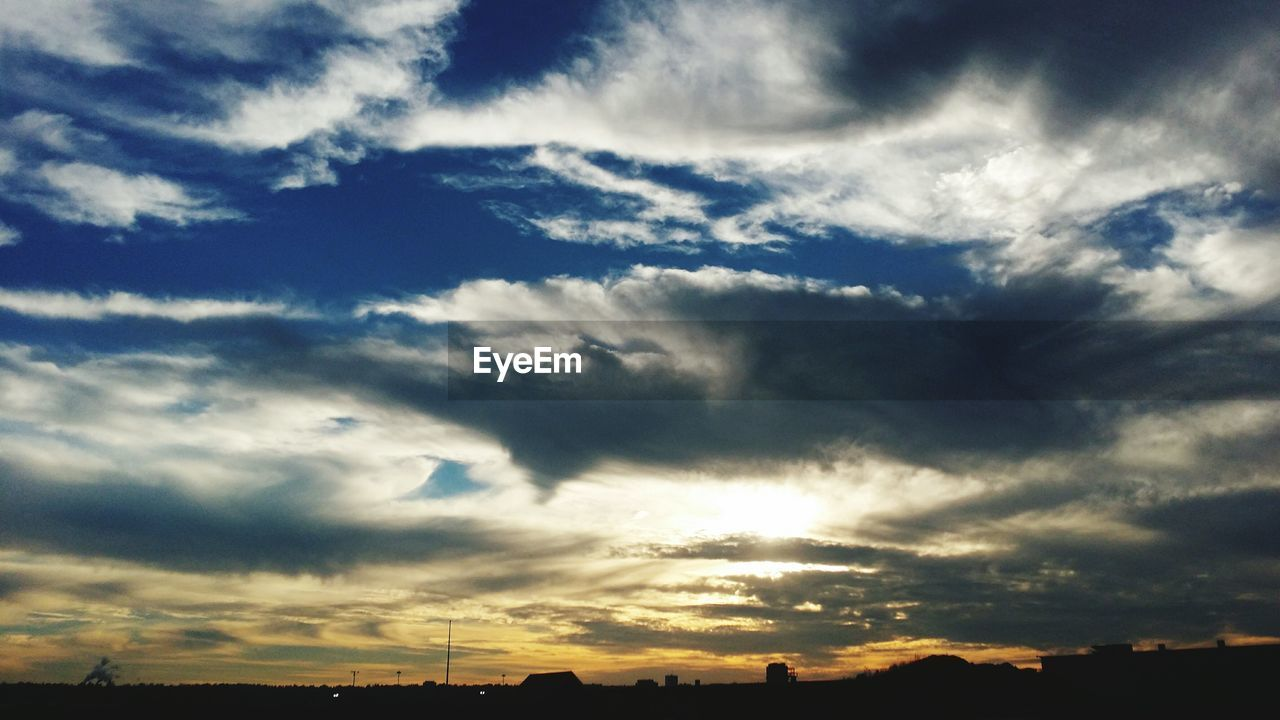 cloud - sky, sky, beauty in nature, atmospheric mood, nature, dramatic sky, scenics, sunset, no people, tranquility, low angle view, silhouette, outdoors, backgrounds, storm cloud, day