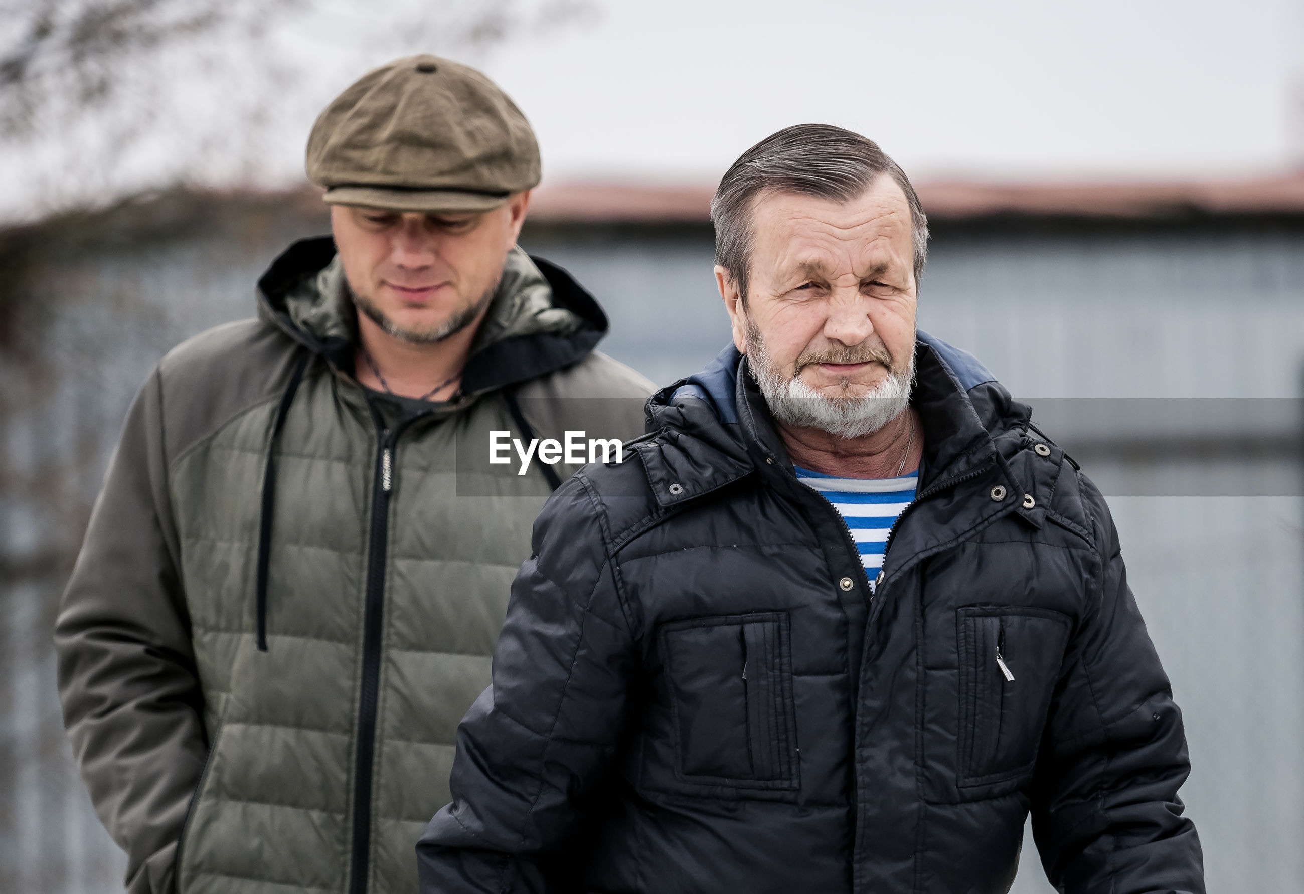 Two men together in warm clothes outdoors in winter