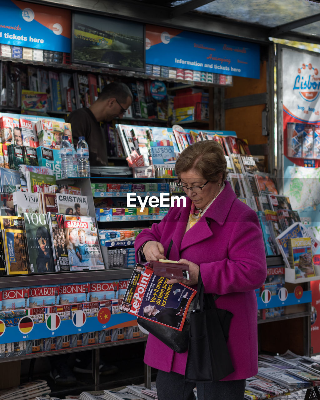 WOMAN STANDING IN A STORE