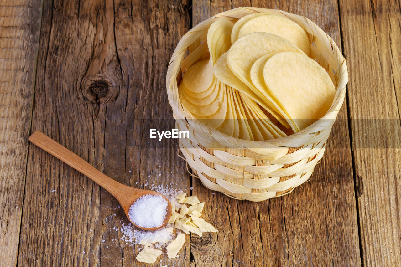 wood - material, food and drink, food, still life, table, freshness, indoors, high angle view, kitchen utensil, no people, close-up, spoon, eating utensil, directly above, brown, wellbeing, container, healthy eating, indulgence, sweet food, temptation