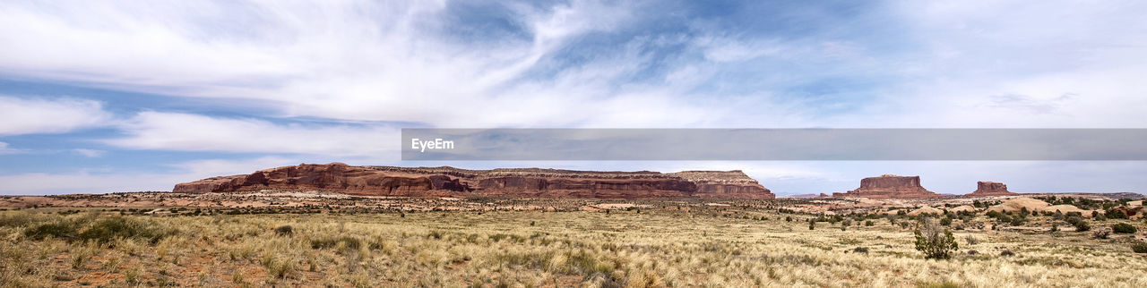 rock formation, rock - object, nature, landscape, geology, beauty in nature, tranquil scene, sky, physical geography, tranquility, cloud - sky, scenics, travel destinations, outdoors, day, no people, arid climate, grass