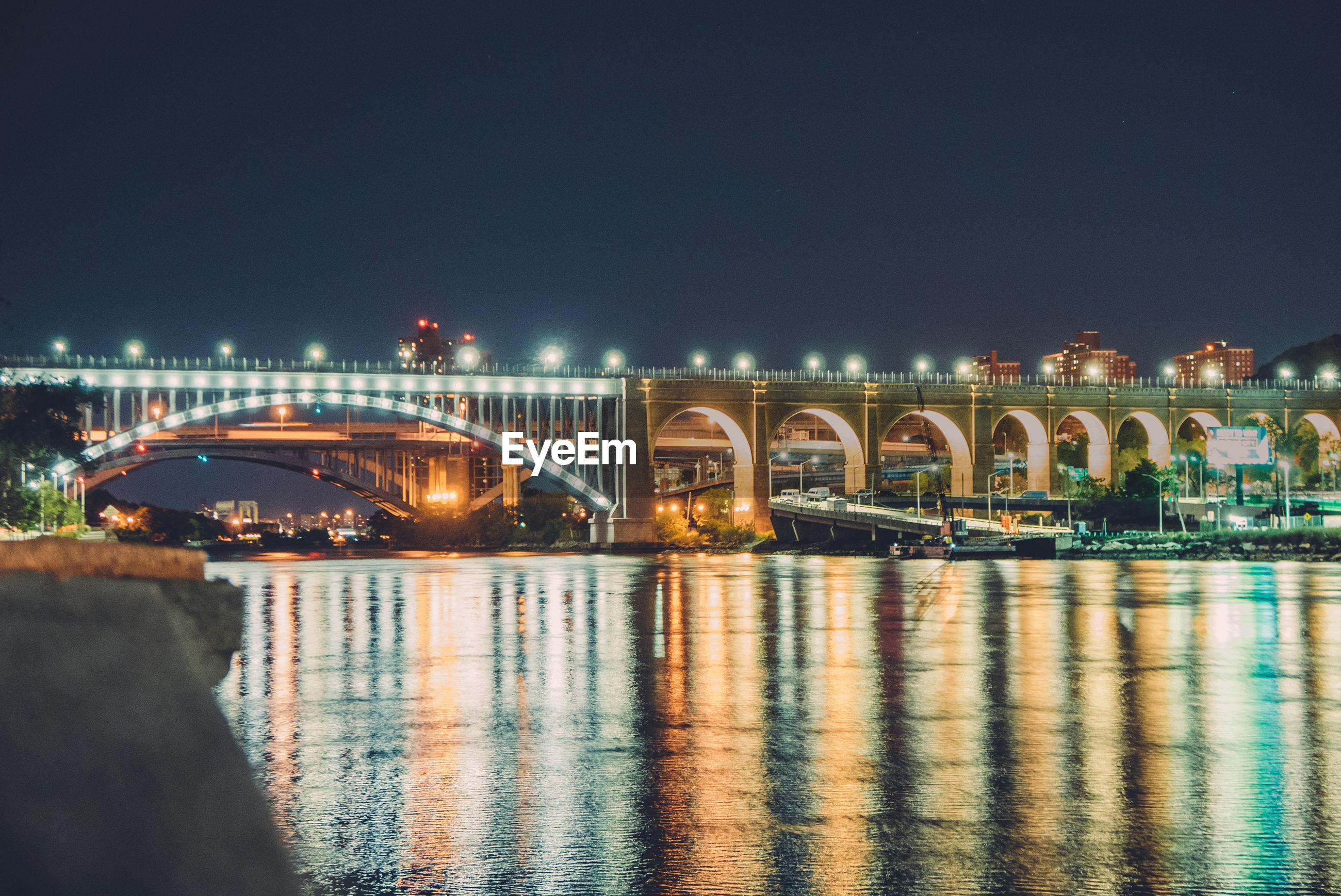 connection, bridge - man made structure, architecture, built structure, water, illuminated, waterfront, river, night, reflection, engineering, bridge, arch bridge, arch, building exterior, city, calm, rippled, tranquility, water surface, city life, travel destinations, tranquil scene, scenics, outdoors, dark, sky, famous place