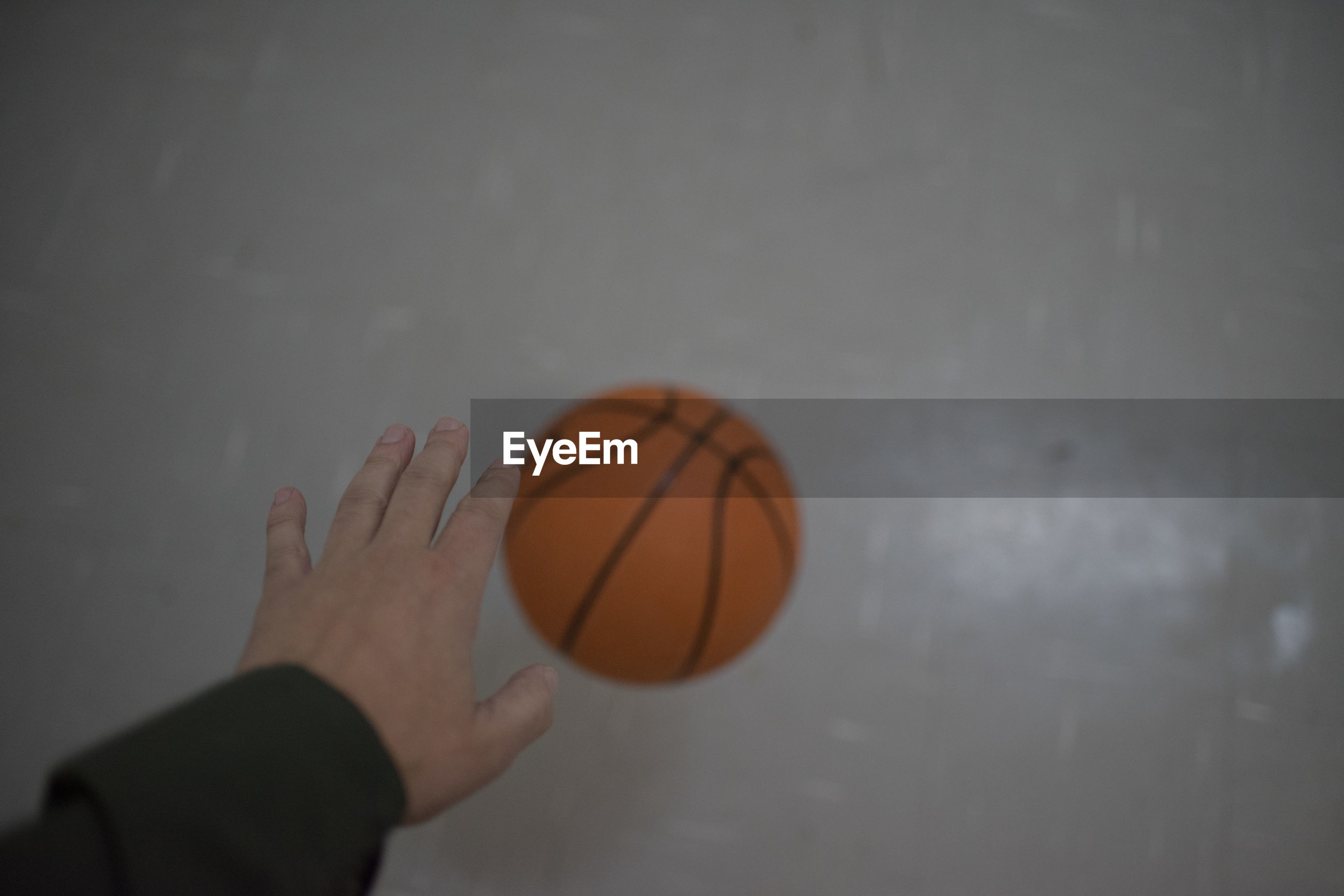 Close-up of person playing basketball