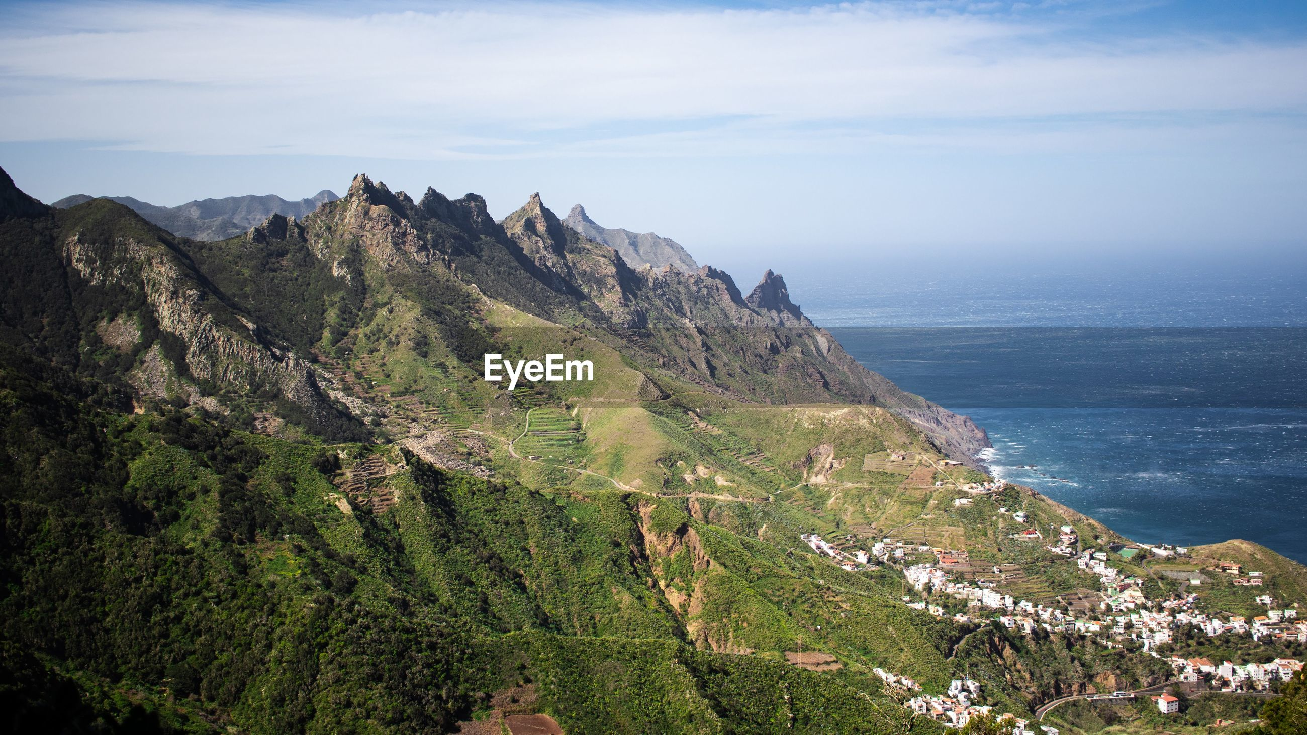 HIGH ANGLE VIEW OF MOUNTAINS AND SEA AGAINST SKY