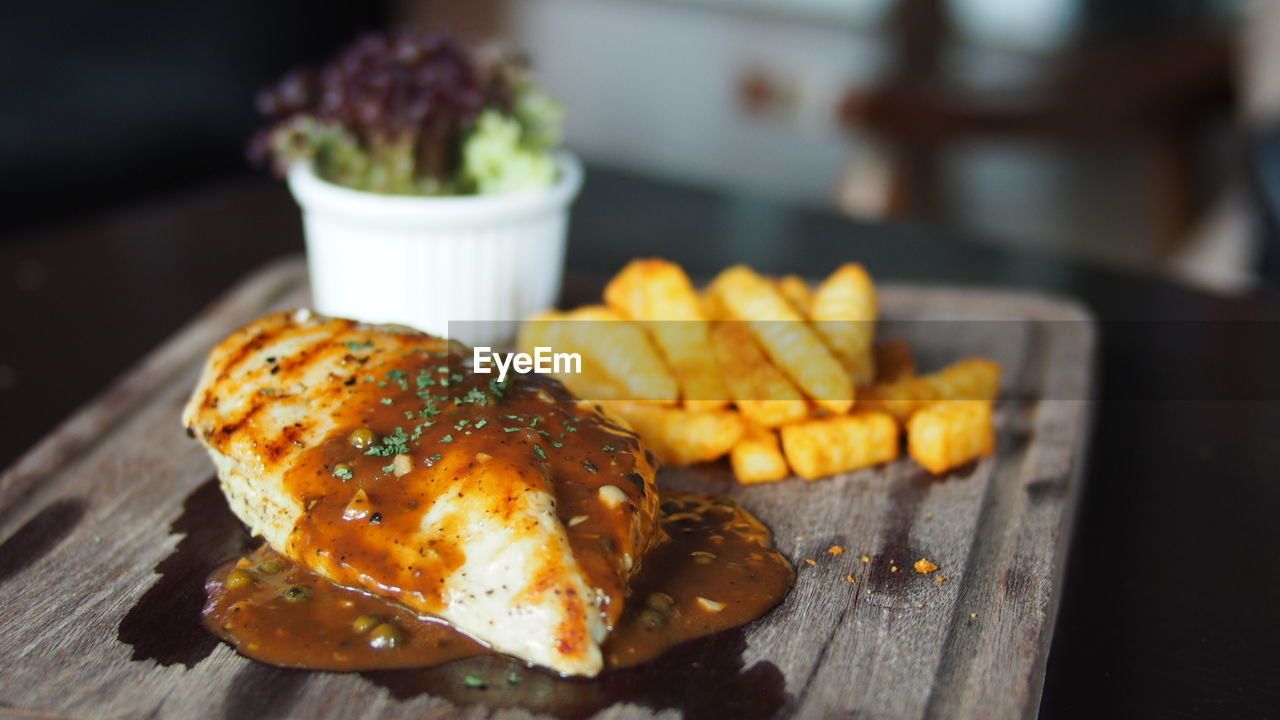 Close-Up Of Chicken Steak With Fries