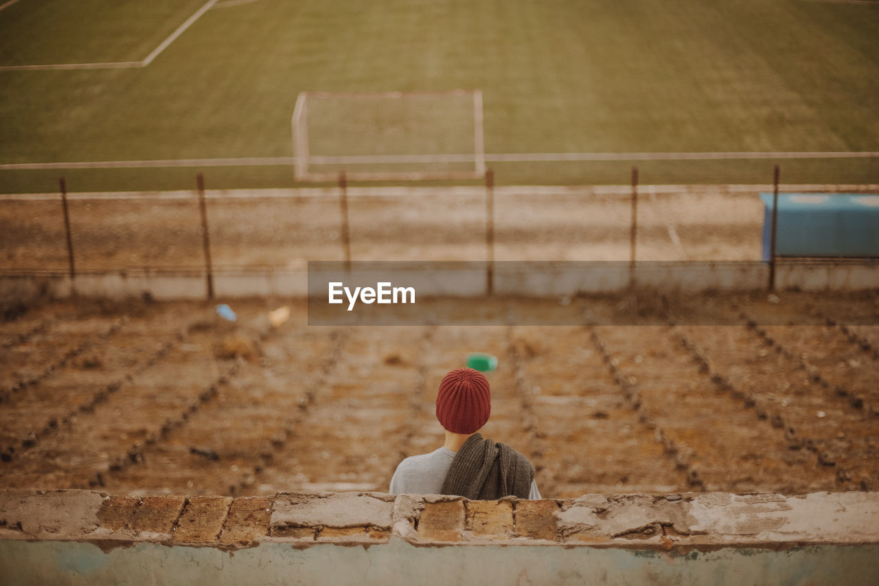 Rear View Of Person In Empty Soccer Stadium