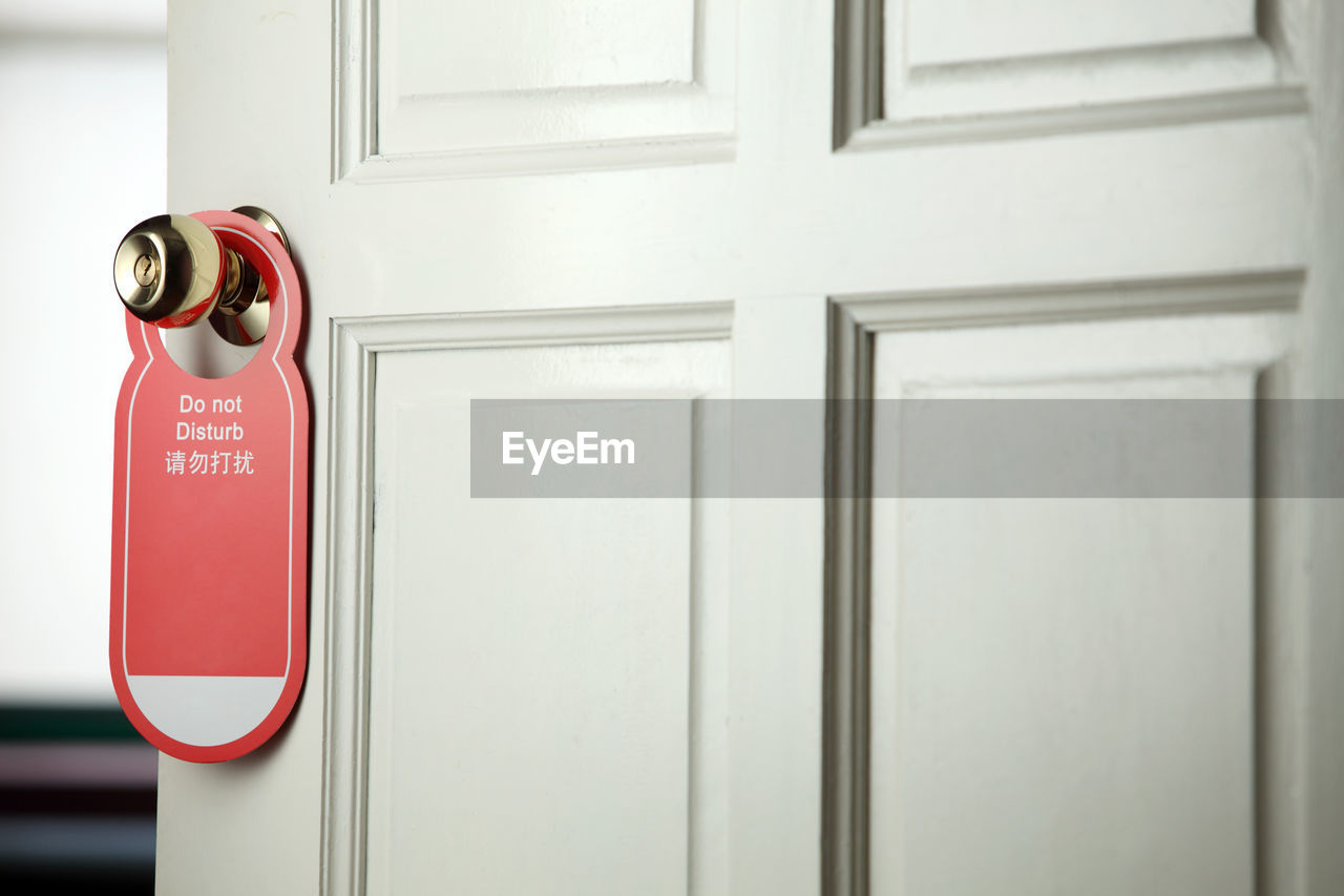 safety, security, protection, door, entrance, indoors, no people, red, close-up, accidents and disasters, emergency equipment, technology, communication, day, white color, handle, glass - material, focus on foreground, text, equipment, push button, fire hose