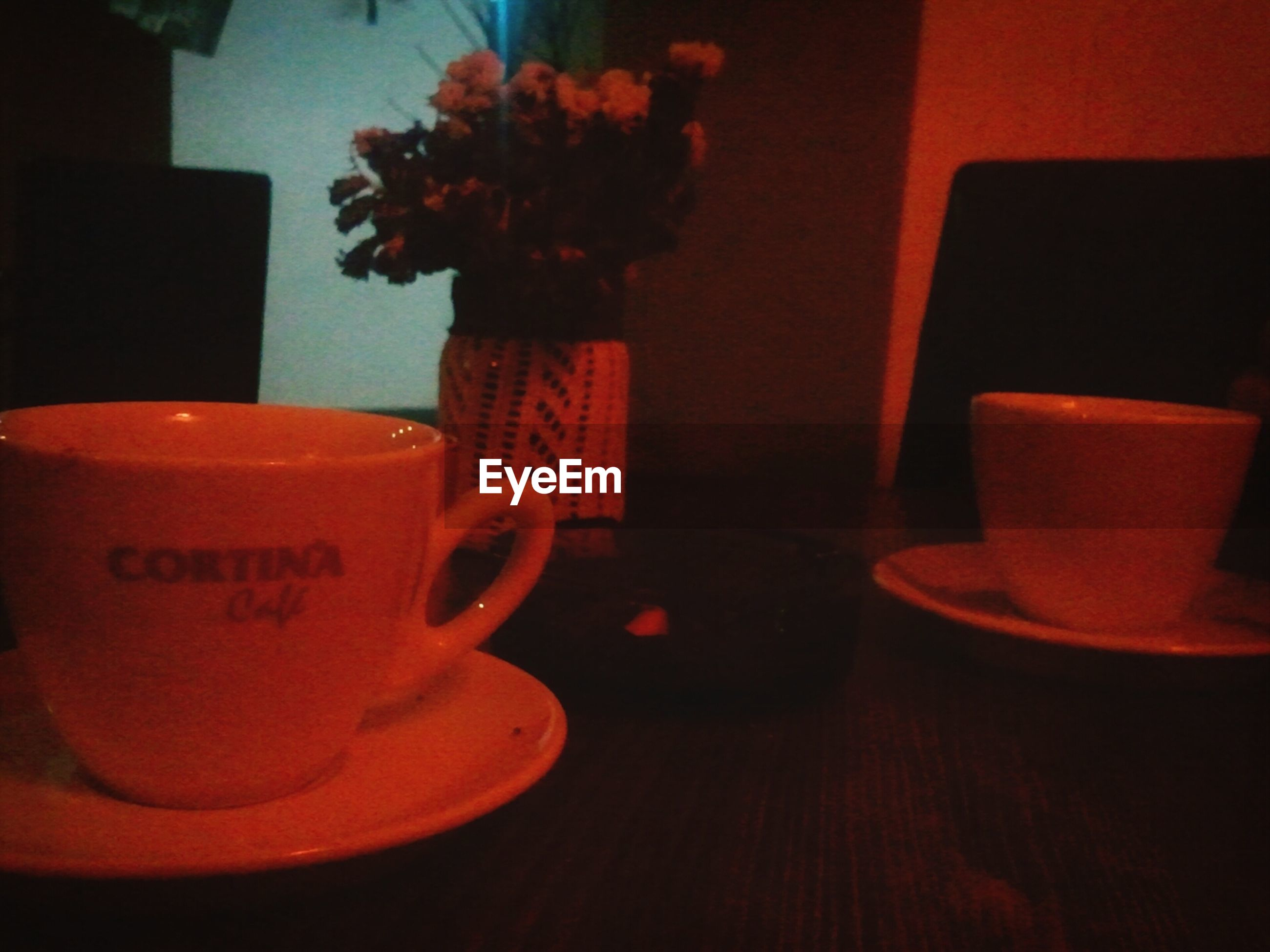 indoors, table, still life, close-up, home interior, coffee cup, drink, no people, food and drink, communication, red, chair, text, focus on foreground, cup, freshness, selective focus, book, absence, refreshment
