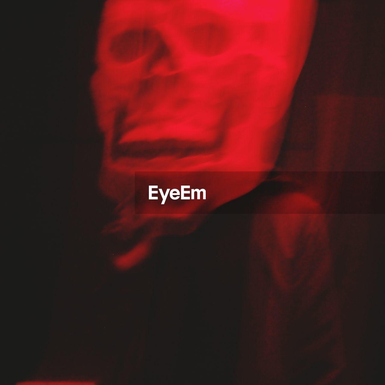 red, no people, close-up, black background, night, indoors, illuminated