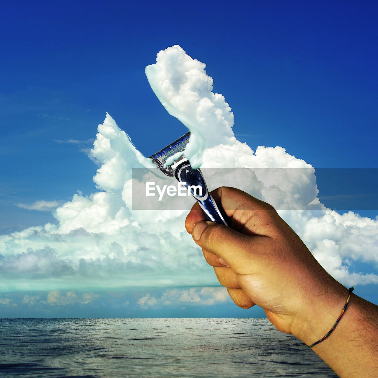 human hand, sky, human body part, cloud - sky, one person, holding, real people, day, outdoors, men, horizon over water, nature, close-up, people