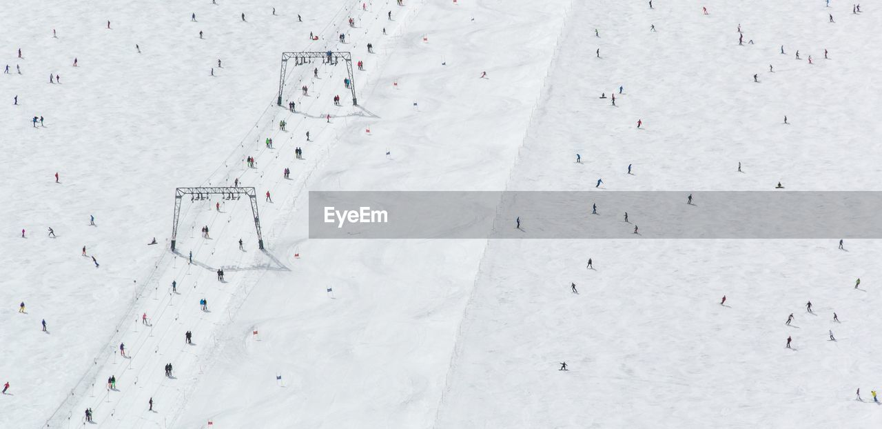 Aerial View Of People On Snowy Landscape