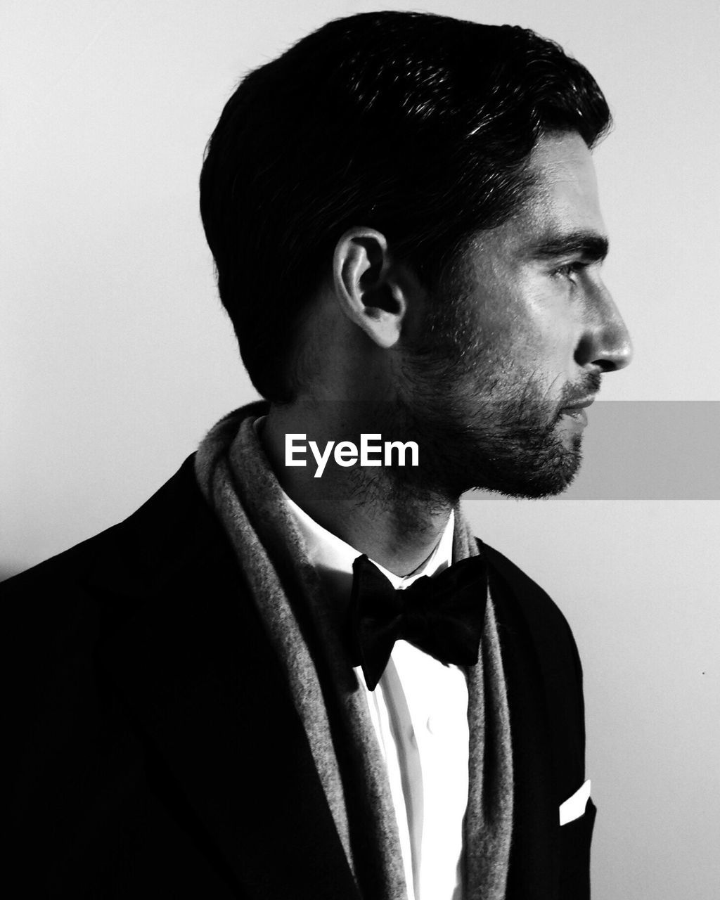 looking away, one person, indoors, looking, studio shot, young adult, beard, young men, facial hair, handsome, men, formalwear, portrait, side view, standing, lifestyles, headshot, close-up, menswear, contemplation