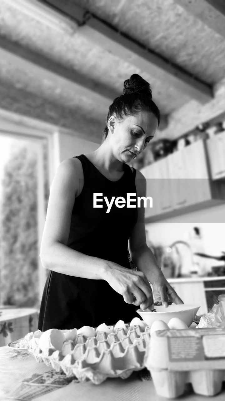 Young woman preparing food in kitchen