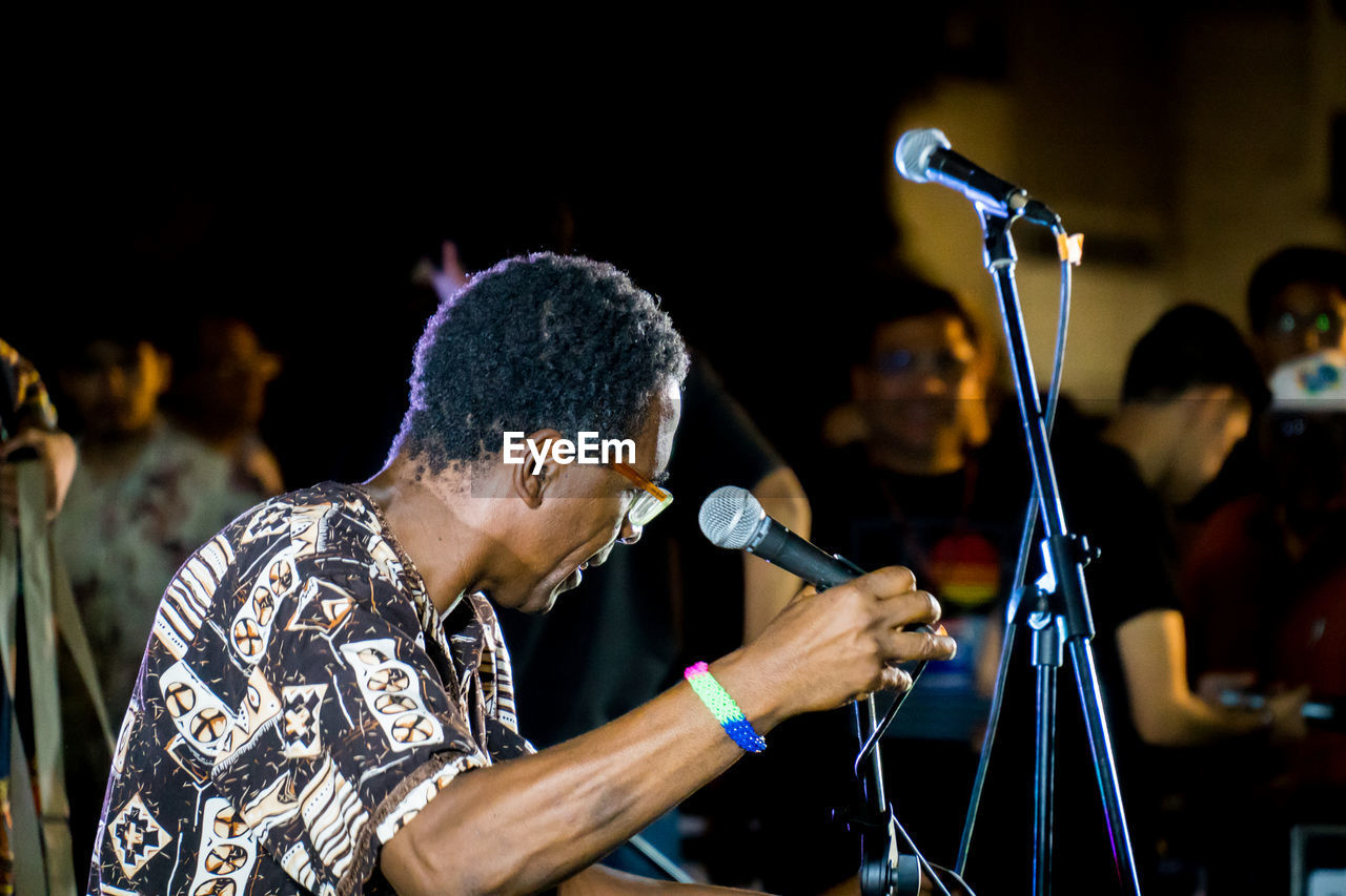 Singer Holding Microphone On Stage