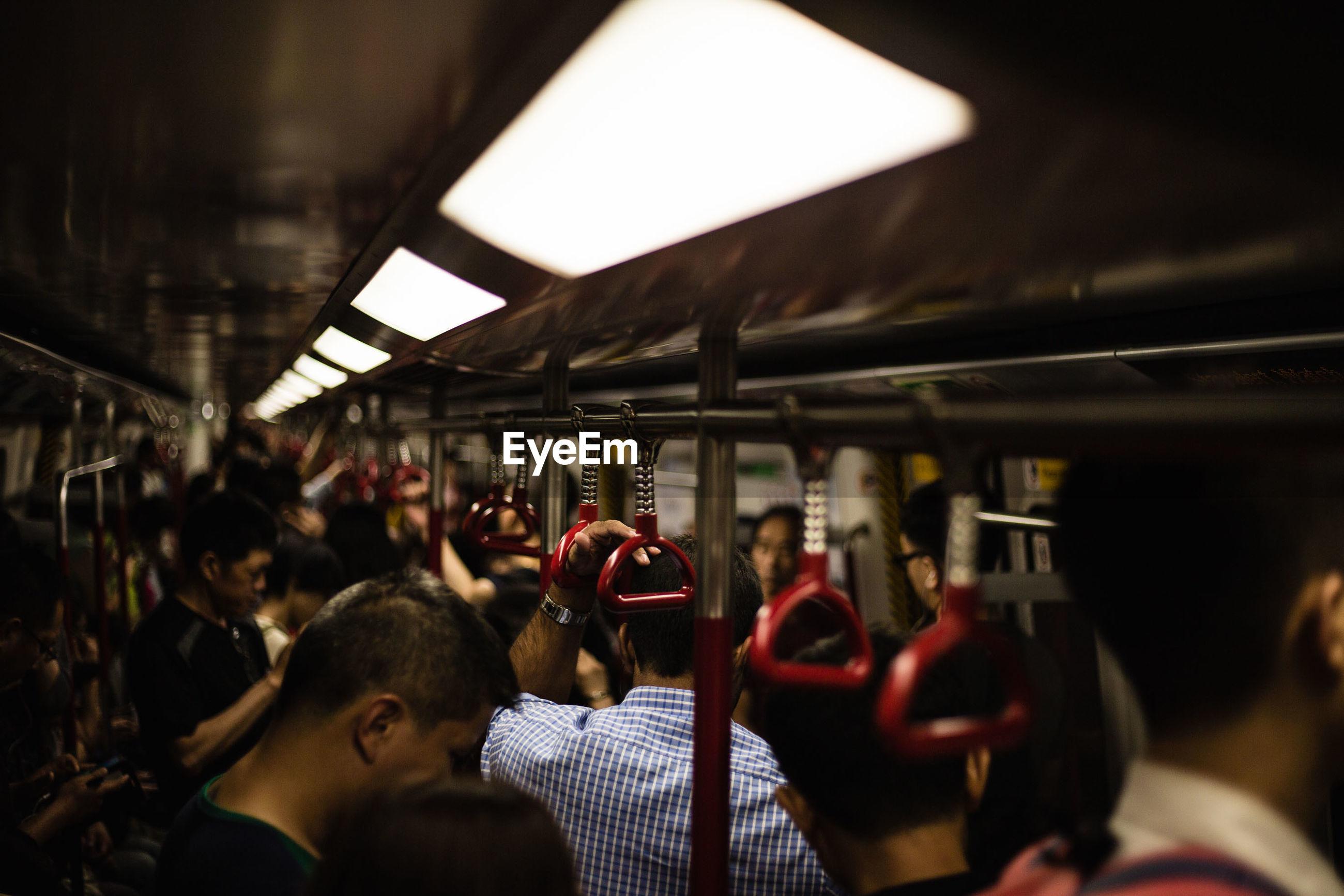 View of crowd in illuminated subway train