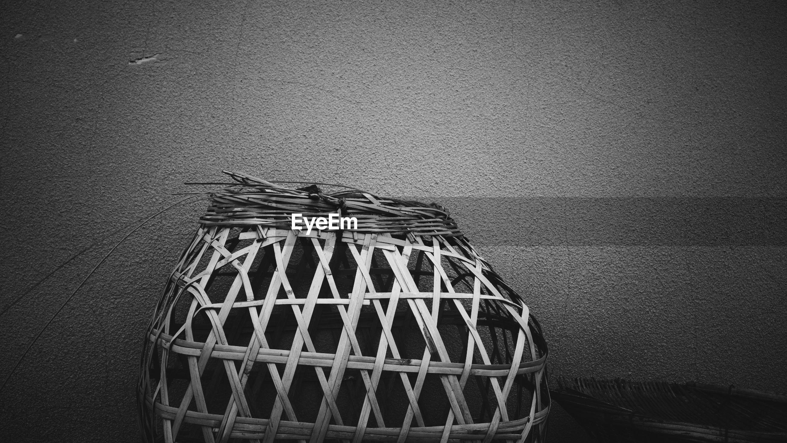 Wicker basket by wall
