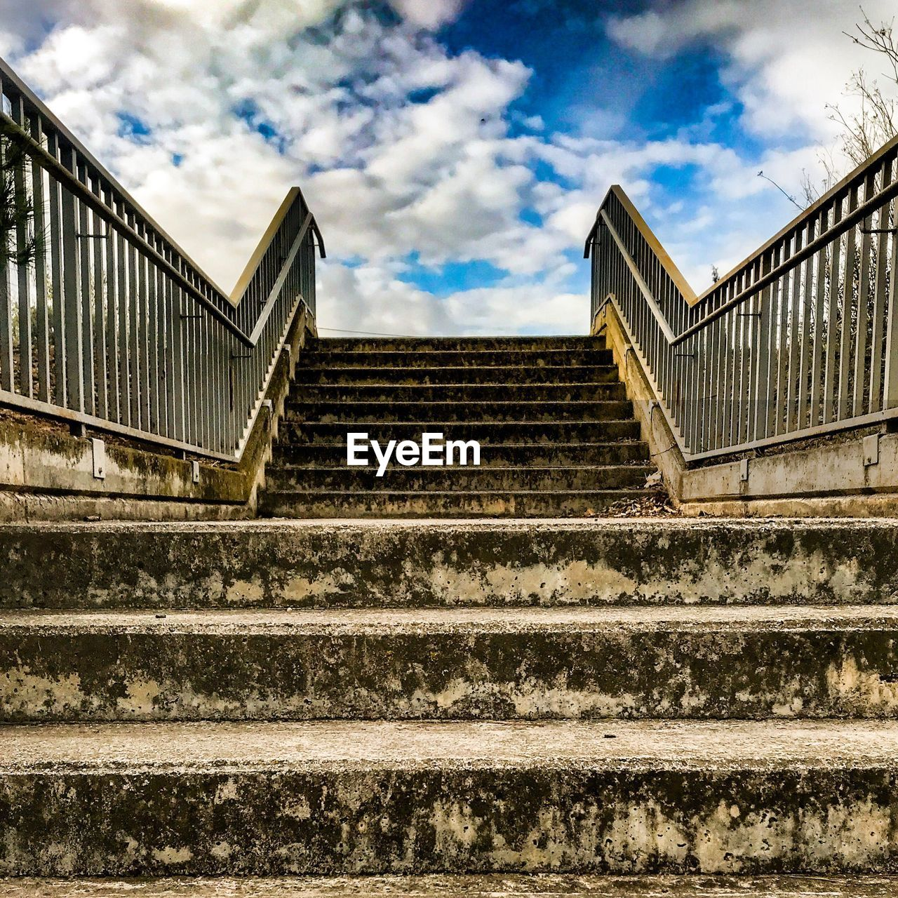 steps, staircase, steps and staircases, railing, stairs, low angle view, sky, architecture, cloud - sky, built structure, hand rail, stairway, no people, day, outdoors