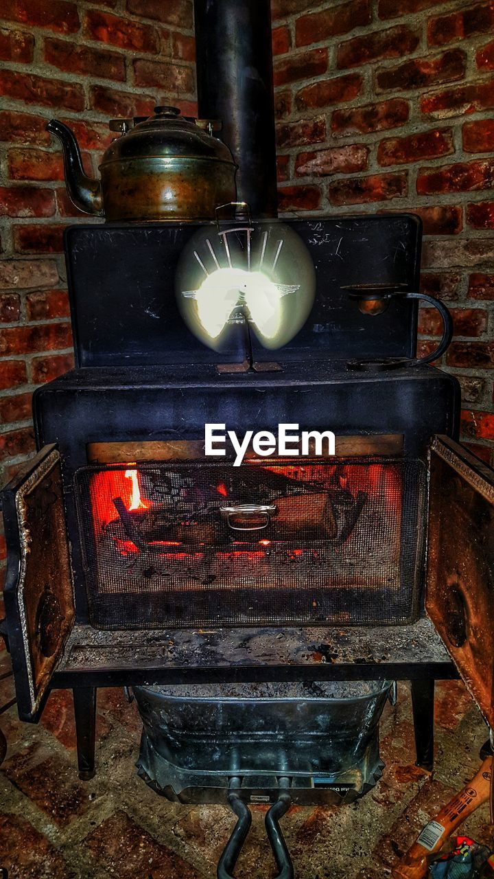 flame, burning, heat - temperature, glowing, fireplace, brick wall, no people, wood - material, old-fashioned, indoors, stove, food, night, camping stove