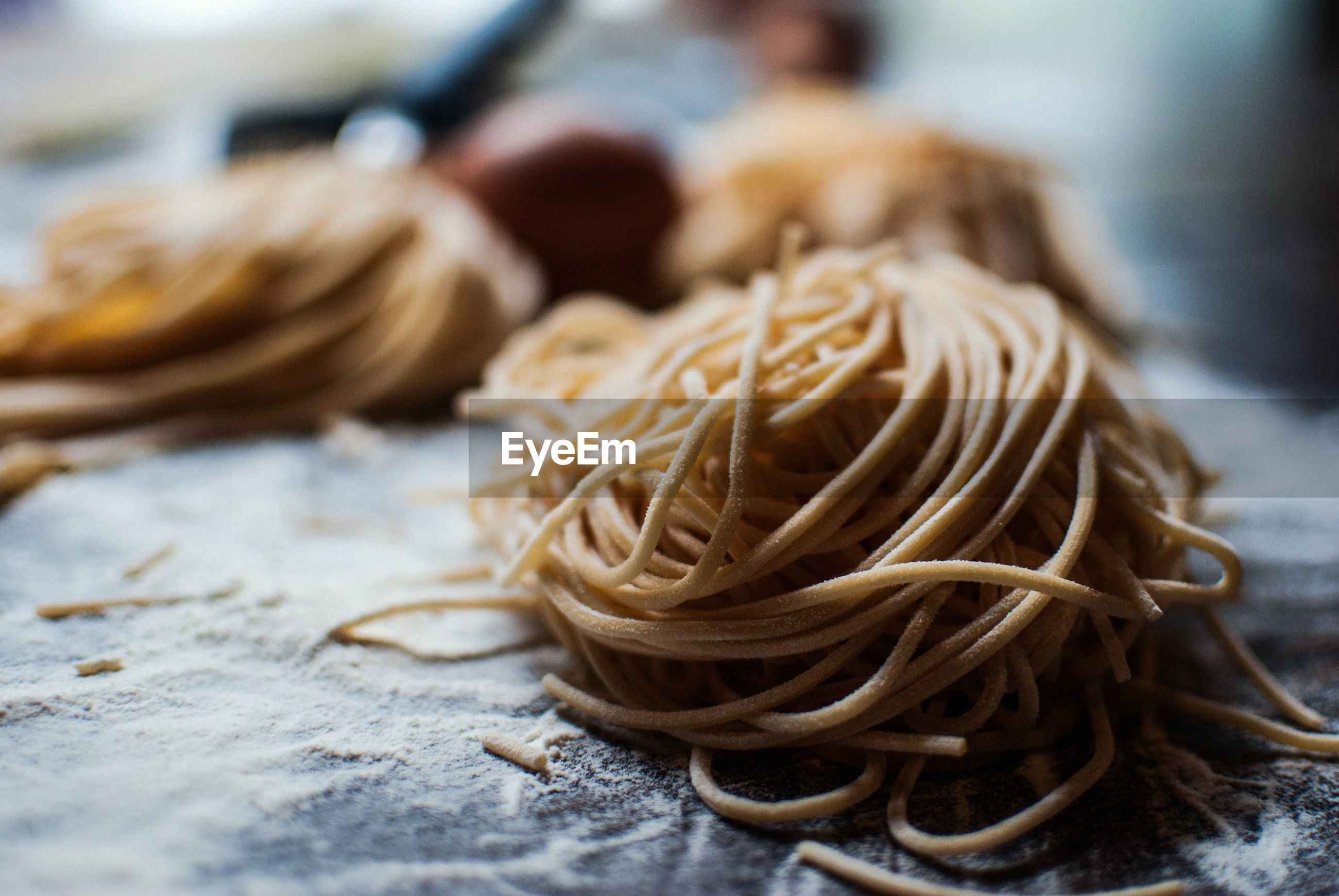 Close-up of pasta with egg on table