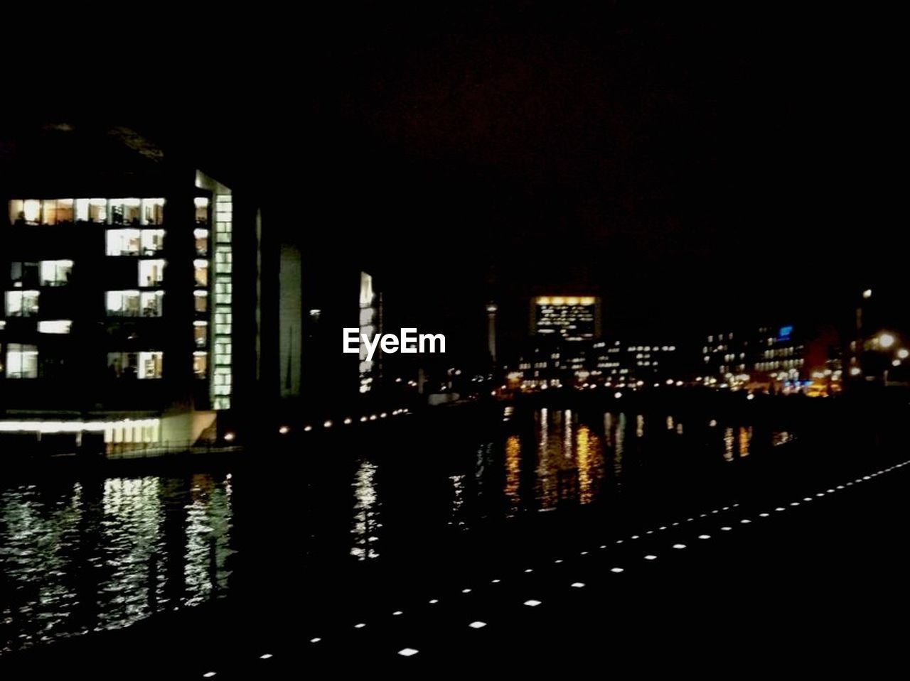 architecture, building exterior, built structure, reflection, illuminated, night, city, water, waterfront, skyscraper, city life, no people, cityscape, modern, residential building, outdoors