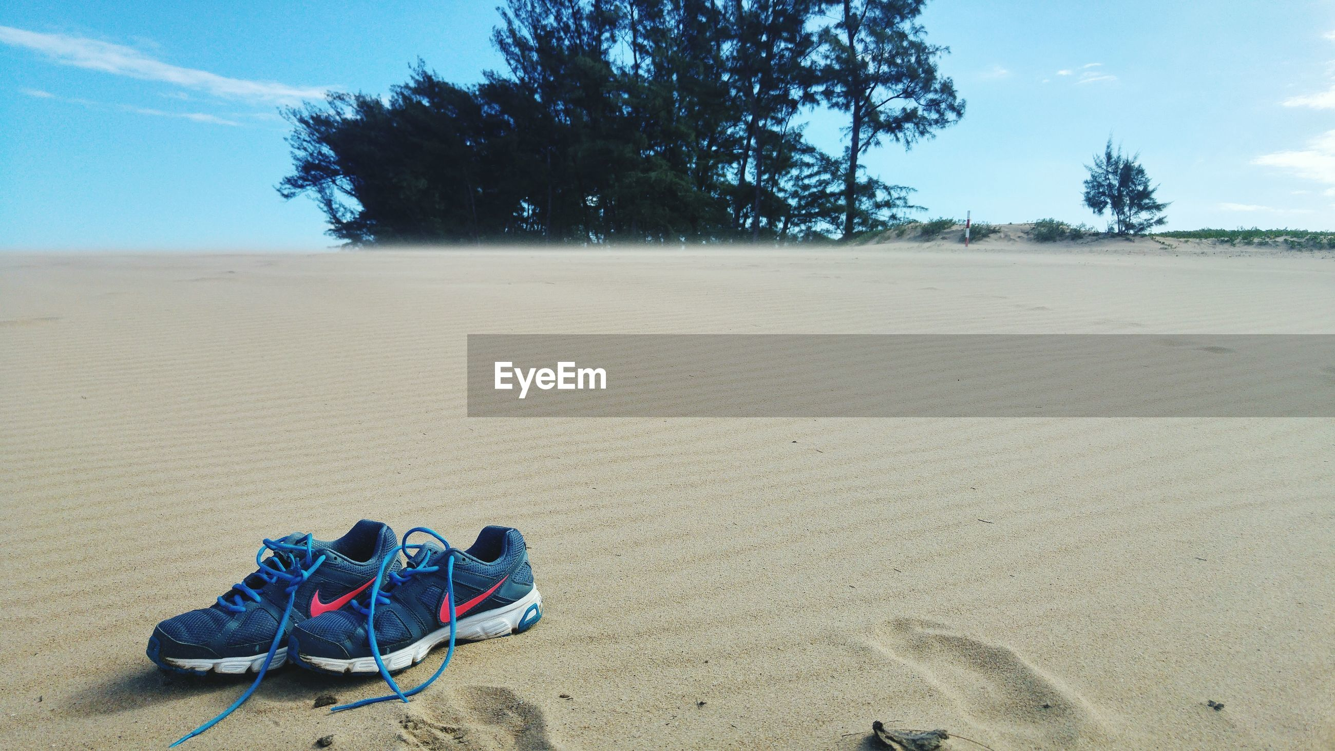 SHOES ON SAND AT BEACH