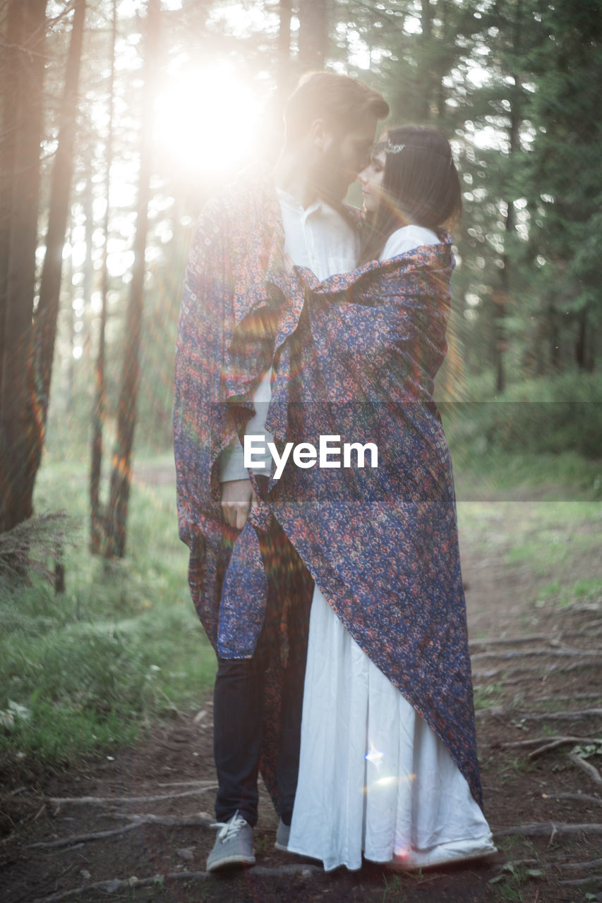 two people, togetherness, women, love, standing, adult, forest, tree, bonding, nature, land, young adult, plant, females, positive emotion, men, emotion, day, couple - relationship, young women, outdoors, lens flare, woodland