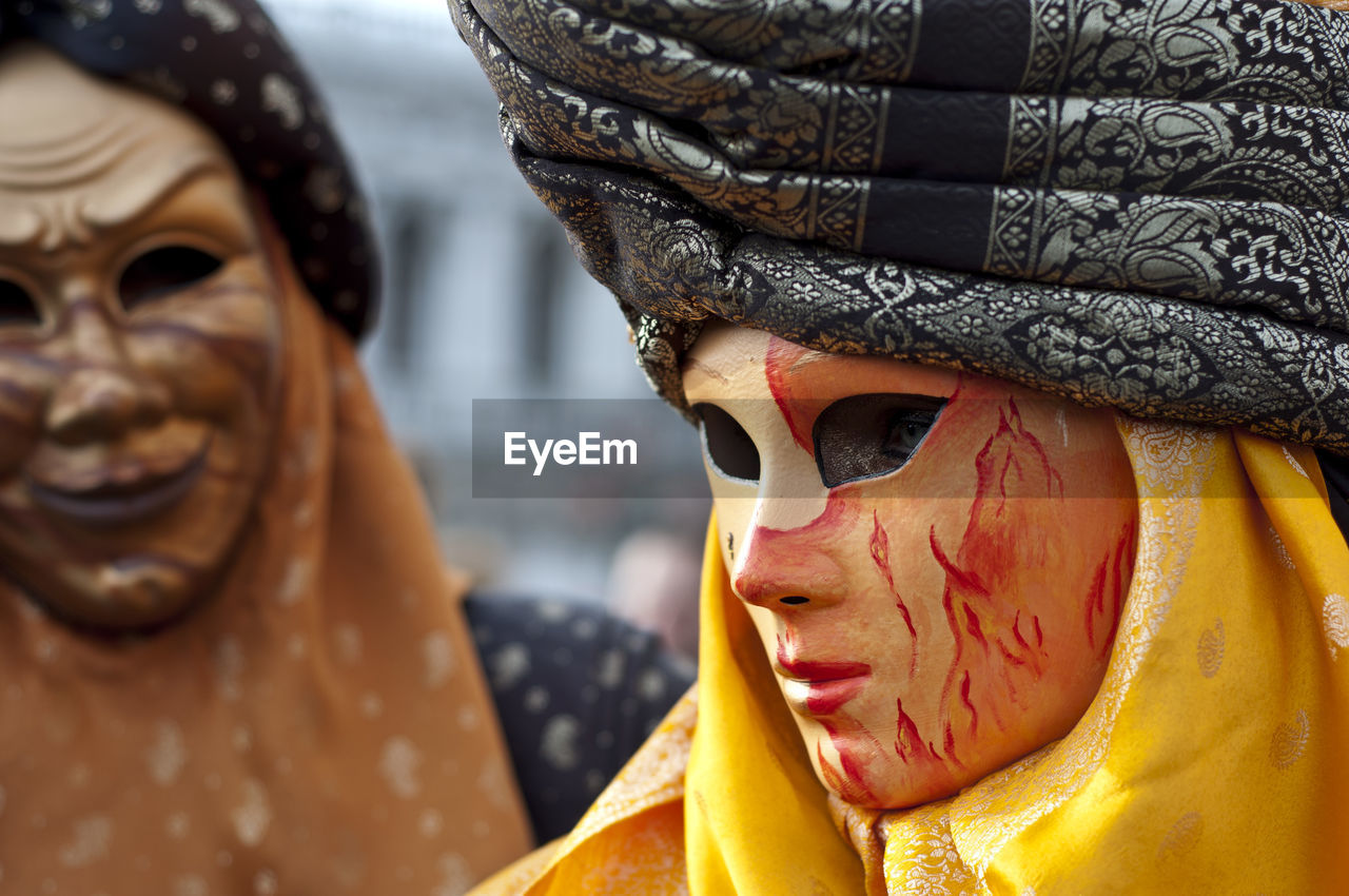 Close-Up Of People Wearing Masks During Carnival