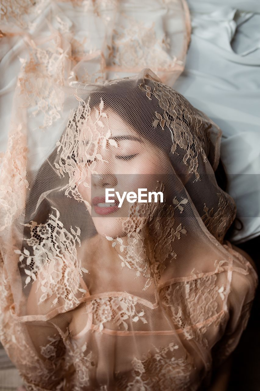 women, young adult, beauty, one person, indoors, beautiful woman, portrait, adult, headshot, young women, wedding, eyes closed, bride, life events, newlywed, wedding dress, hairstyle, event, fashion, lace - textile, contemplation, veil, luxury