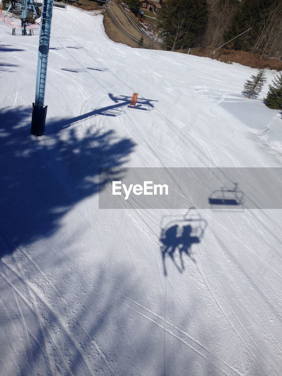 snow, winter, cold temperature, shadow, skiing, winter sport, ski holiday, high angle view, white color, sport, sunlight, nature, day, motion, outdoors, landscape, adventure, snowboarding, ski lift, extreme sports, warm clothing, one person, people
