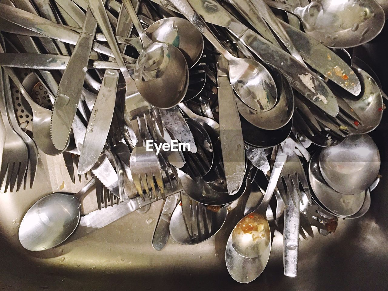 Close-Up Of Silverware In Sink