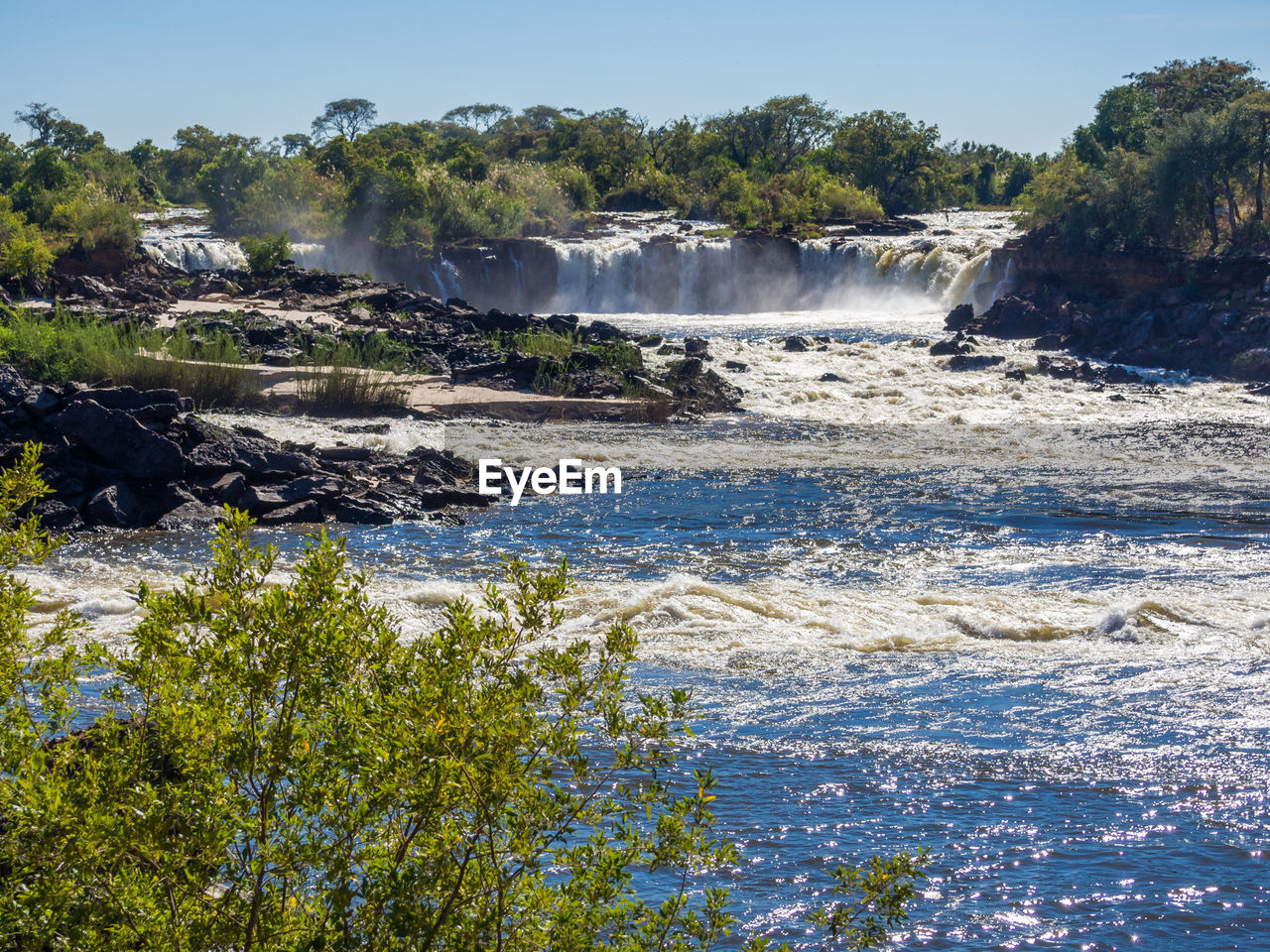 Scenic view of ngonye waterfall against clear sky