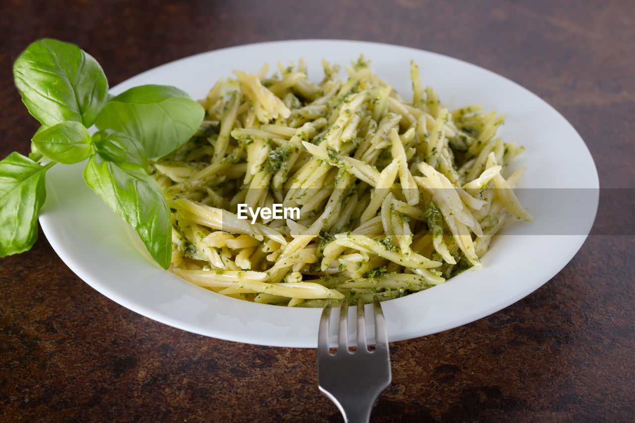 food and drink, food, freshness, healthy eating, wellbeing, italian food, table, still life, pasta, ready-to-eat, vegetable, plate, indoors, serving size, no people, close-up, indulgence, kitchen utensil, high angle view, herb, garnish, spaghetti, vegetarian food, temptation, crockery
