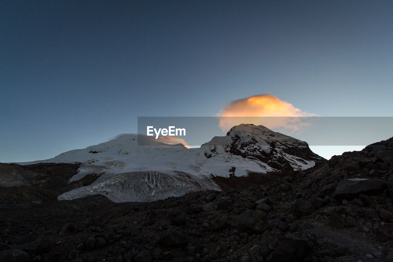 mountain, sky, beauty in nature, volcano, scenics - nature, nature, non-urban scene, no people, smoke - physical structure, environment, tranquil scene, geology, tranquility, landscape, clear sky, land, erupting, cold temperature, winter, physical geography, outdoors, mountain peak, power in nature, snowcapped mountain