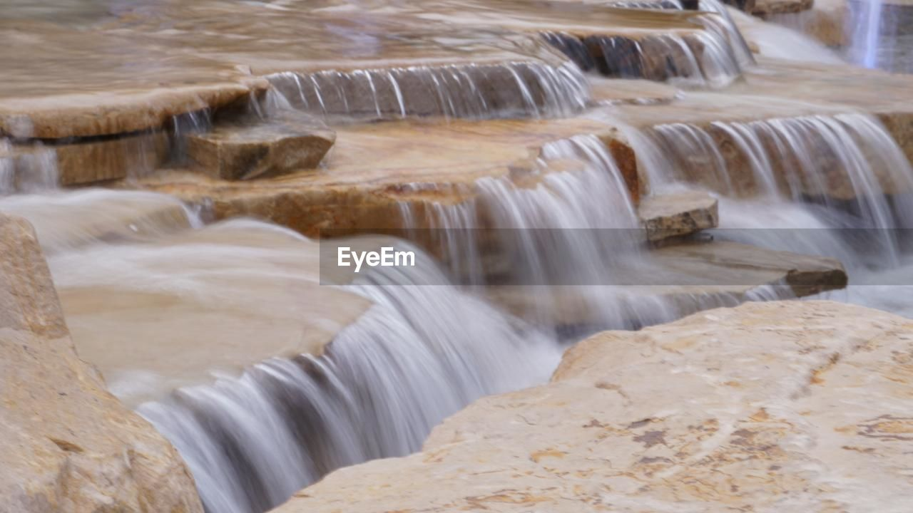 motion, water, long exposure, flowing water, blurred motion, waterfall, nature, river, dam, rock - object, no people, hydroelectric power, outdoors, rapid, beauty in nature, day, hot spring