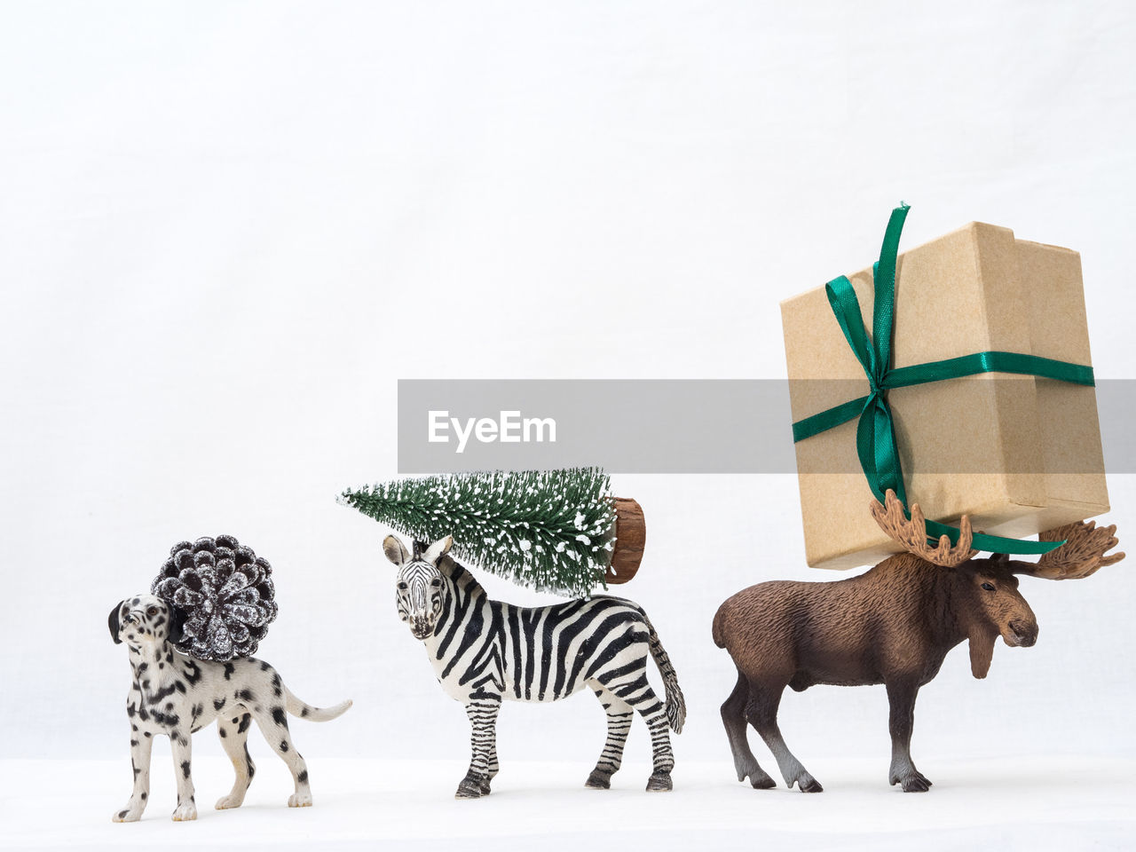 studio shot, mammal, white background, group of animals, animal, copy space, indoors, animal themes, animal representation, no people, representation, domestic animals, still life, art and craft, toy, striped, group of objects, vertebrate, celebration, creativity