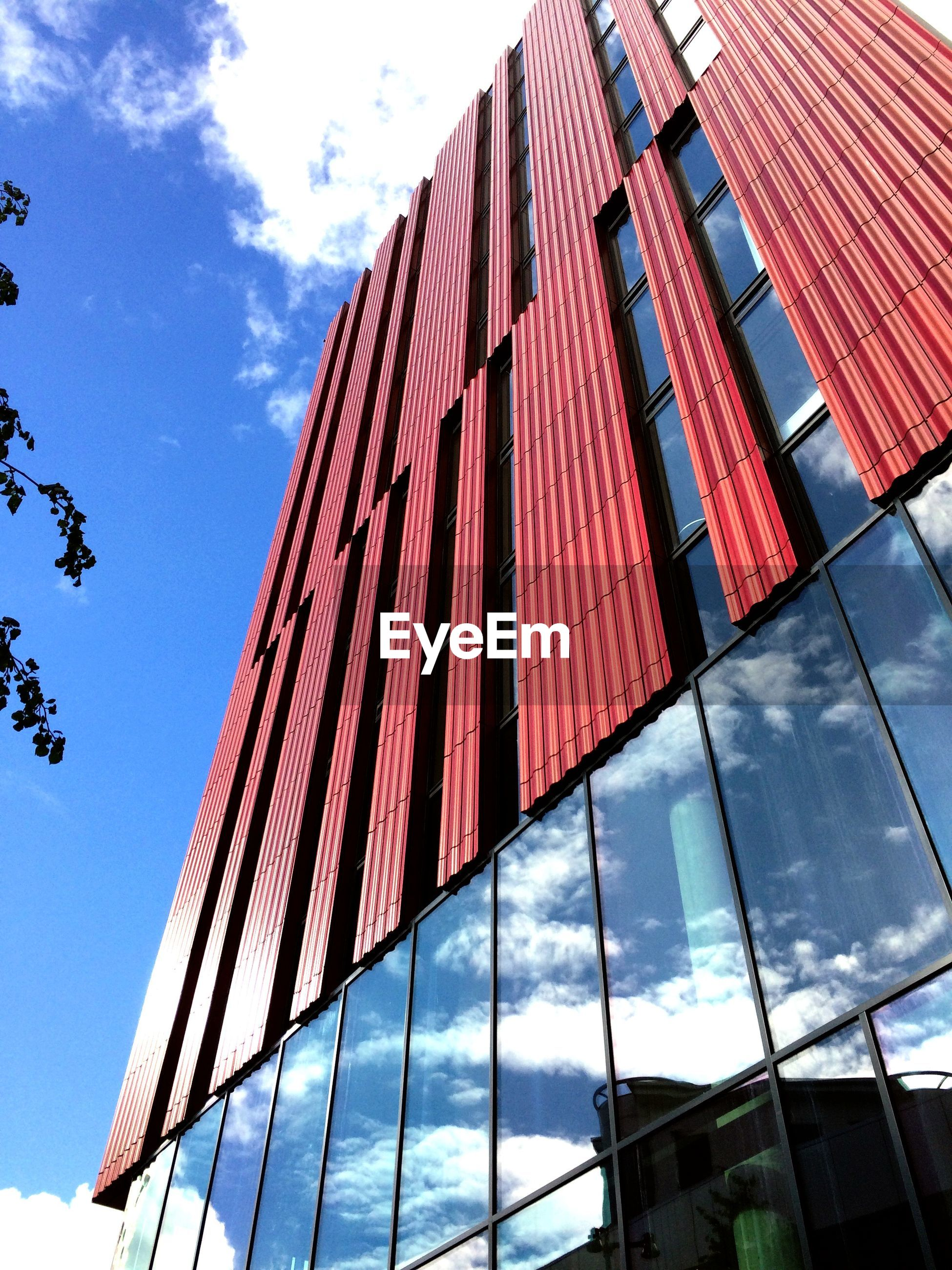 Low angle view of modern building in city against sky