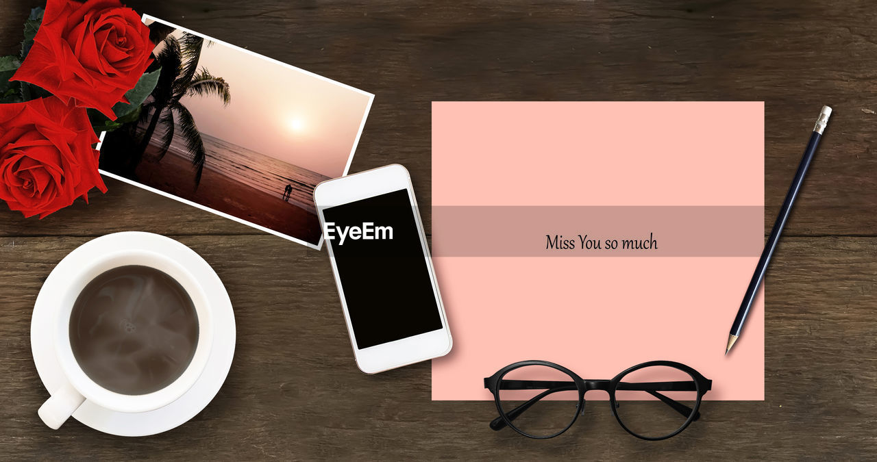 table, high angle view, indoors, coffee cup, text, coffee - drink, directly above, no people, desk, diary, eyeglasses, flower, day, freshness, close-up