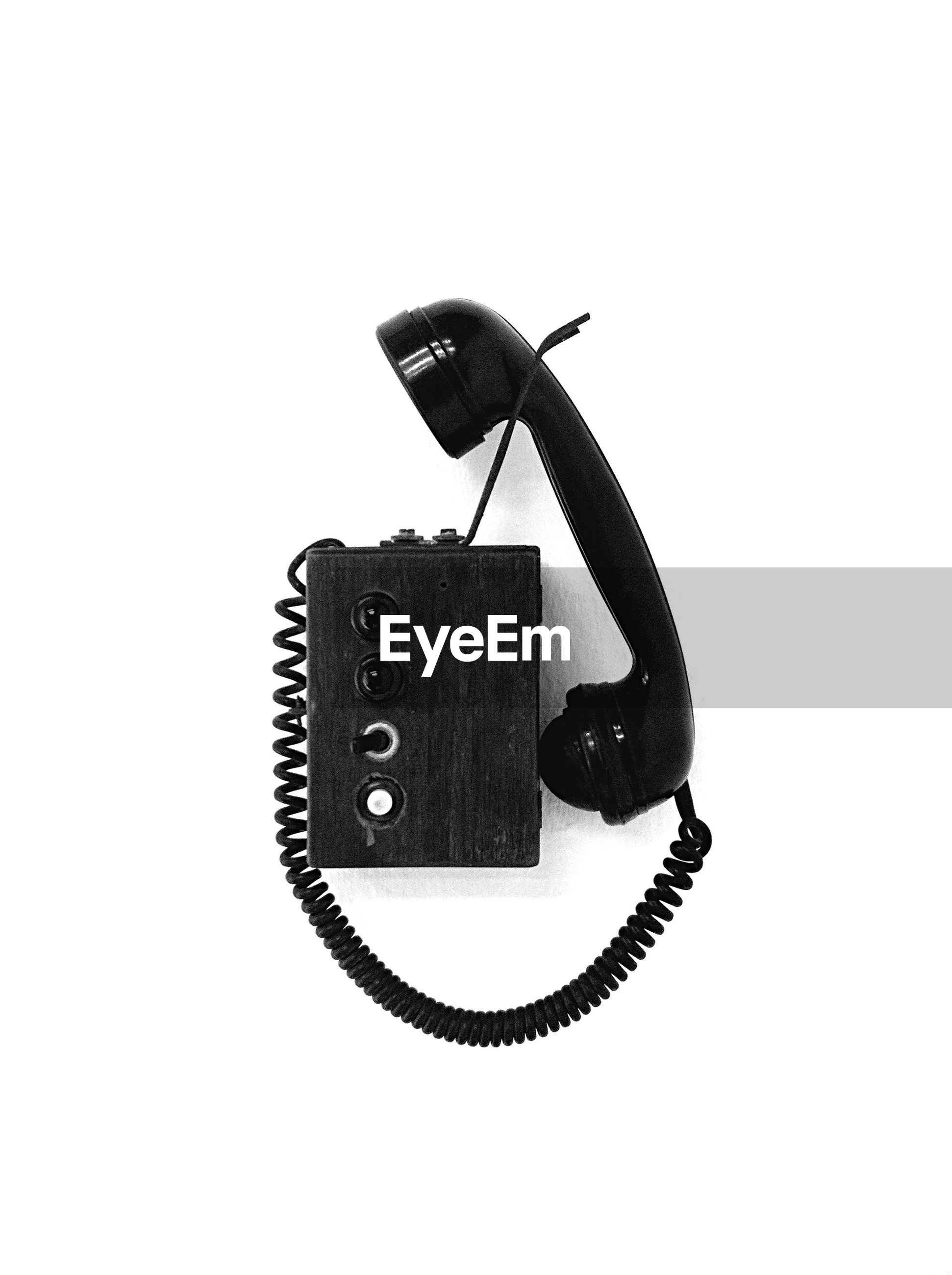 Close-up of old-fashioned telephone on white background