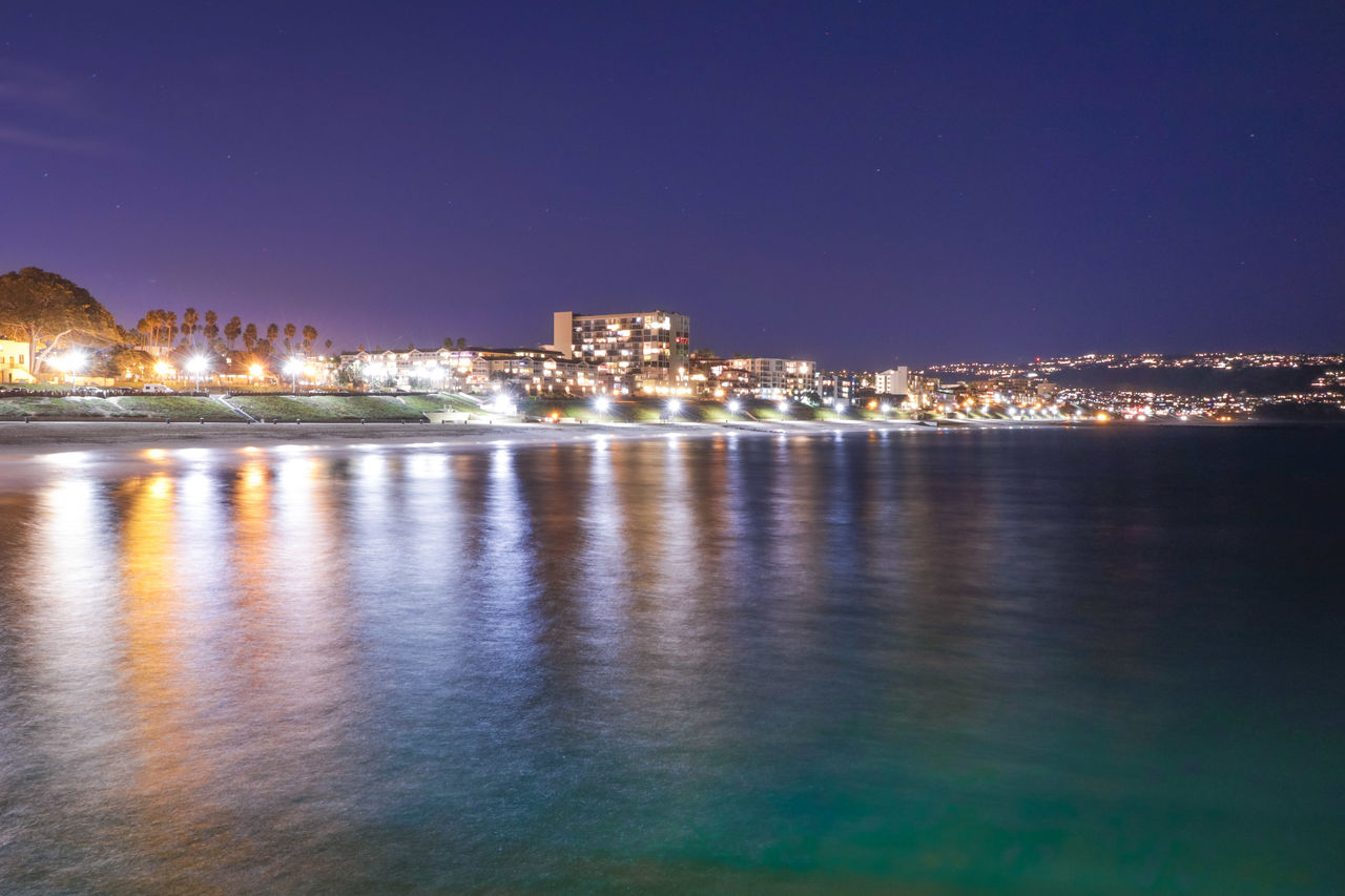 architecture, building exterior, built structure, night, water, sky, city, illuminated, waterfront, no people, nature, reflection, building, sea, cityscape, outdoors, copy space, clear sky