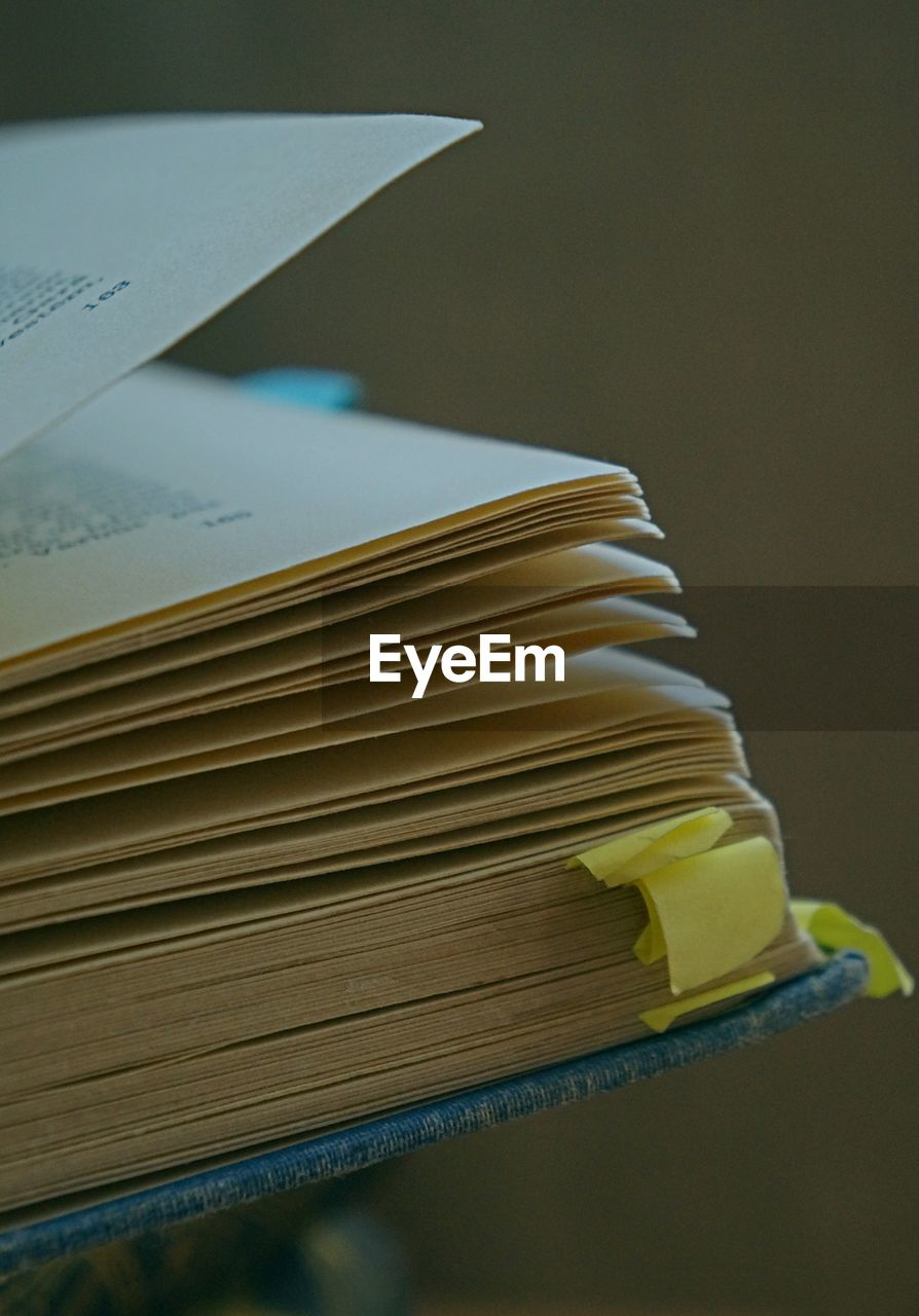 paper, book, education, table, publication, indoors, close-up, still life, stack, learning, no people, focus on foreground, document, page, expertise, literature, yellow, wisdom, open, paperwork, hardcover book